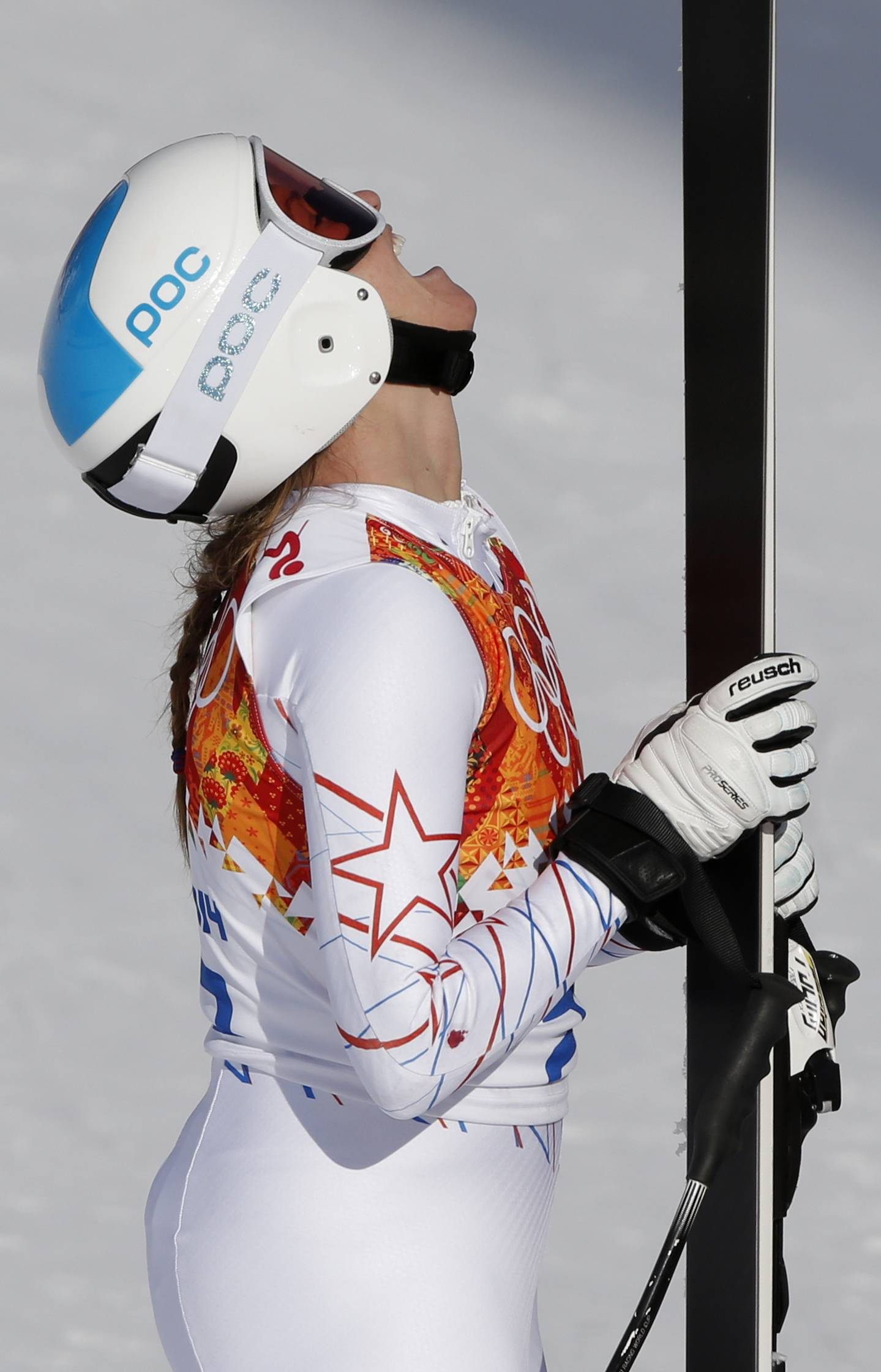 United States' Julia Mancuso rests after finishing the downhill portion of the women's supercombined.