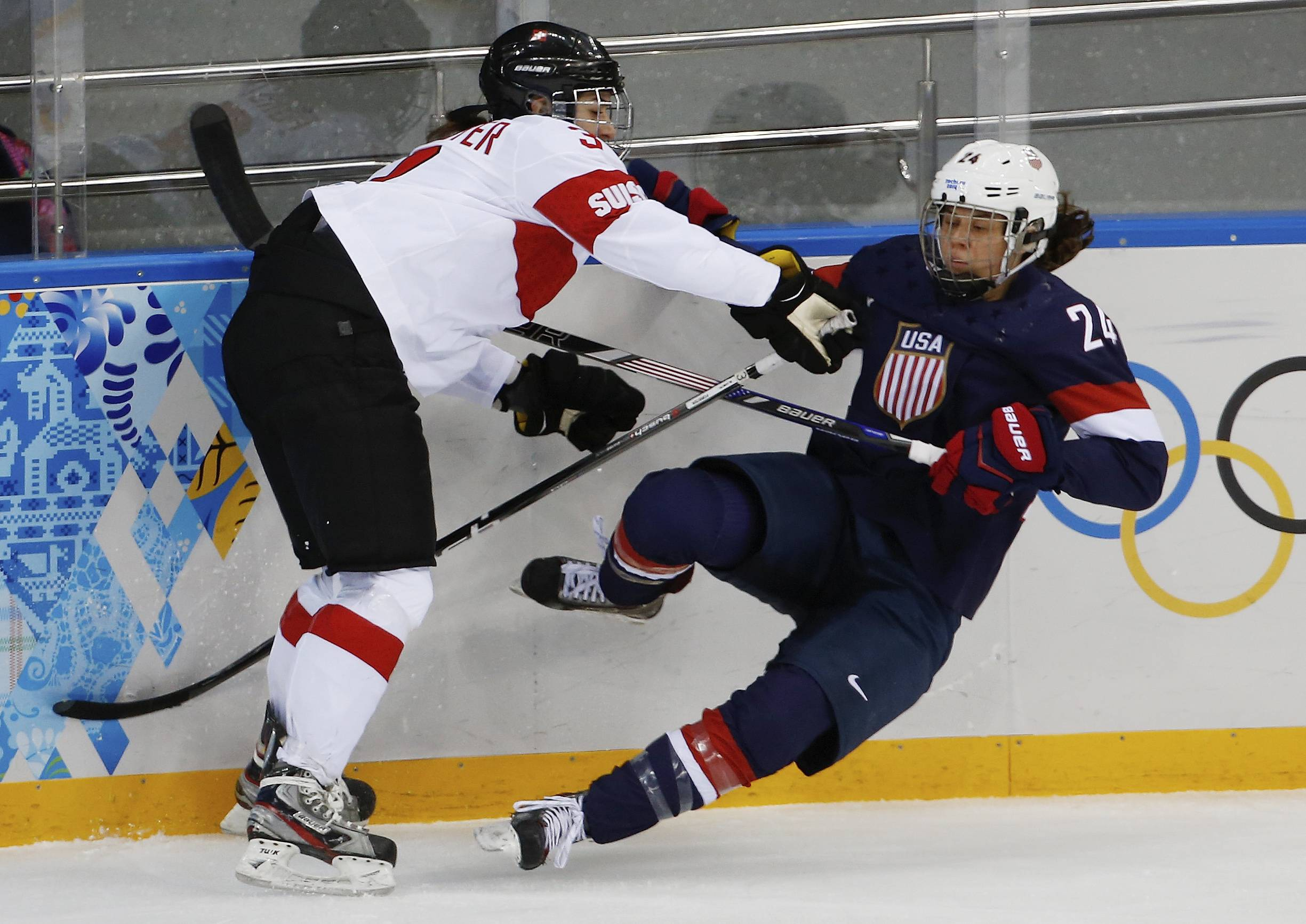 Sarah Forster of Switzerland collides with Josephine Pucci of the Untied States during the first period.