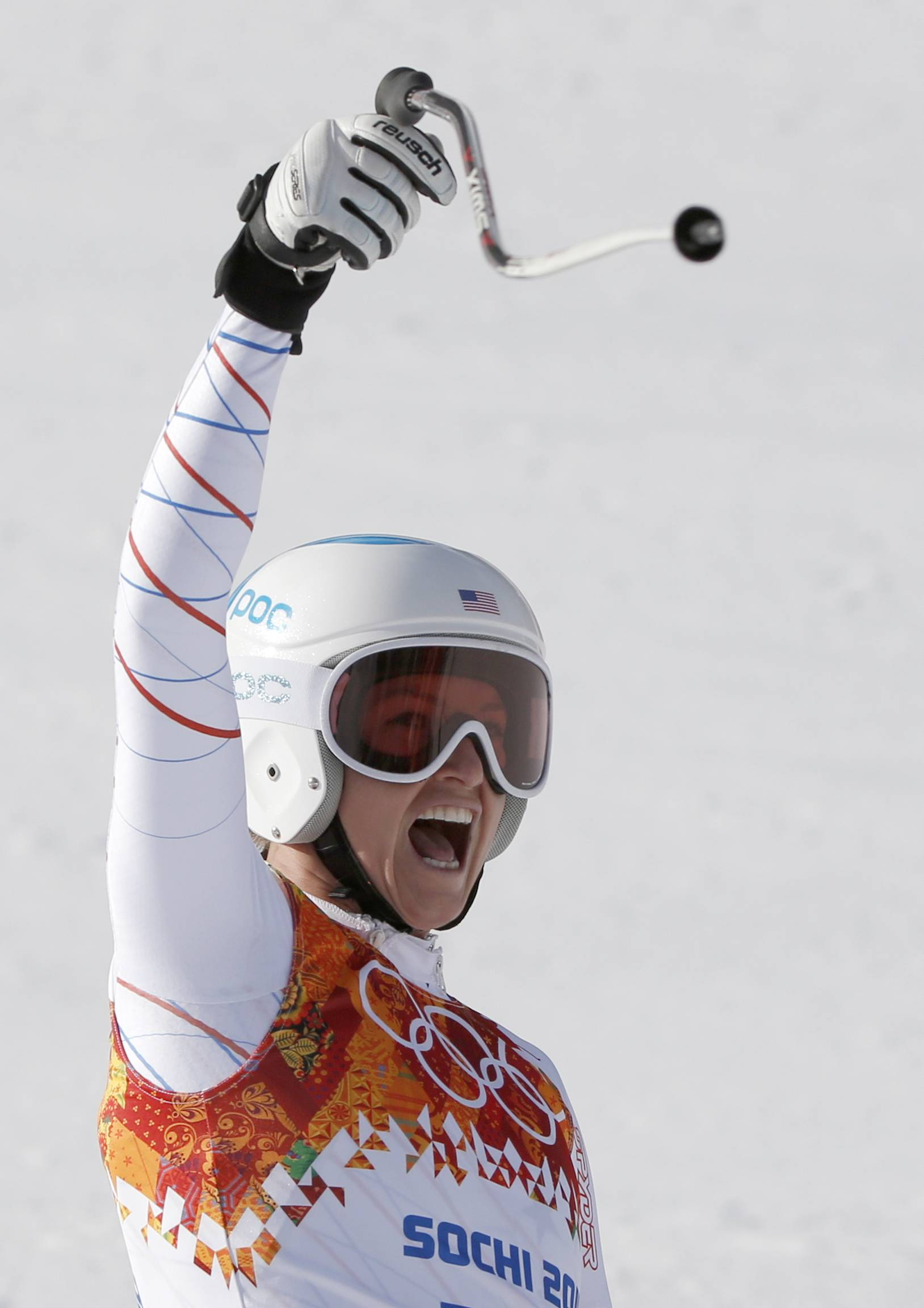 United States' Julia Mancuso celebrates after finishing the downhill portion of the women's supercombined.