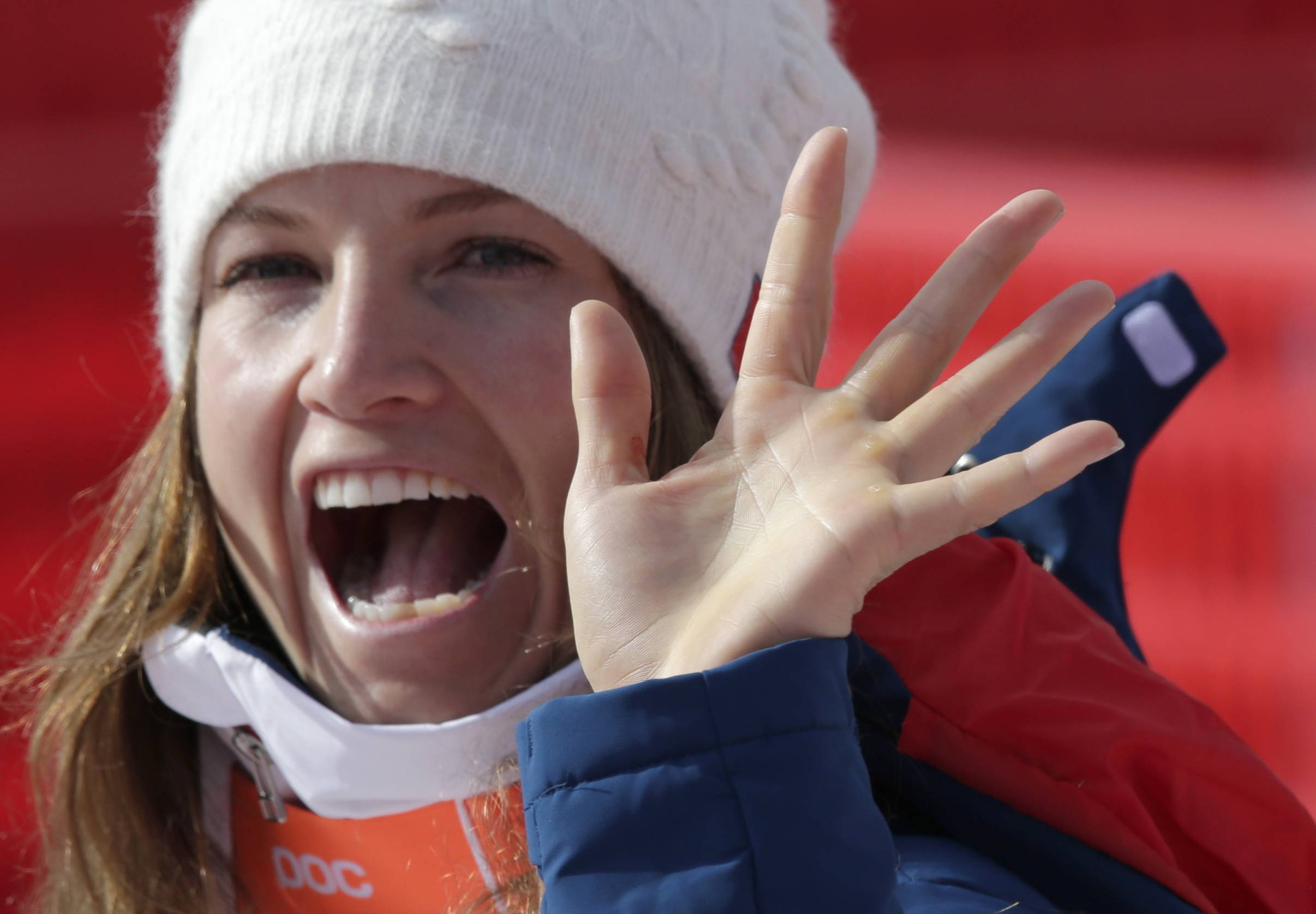United States' Julia Mancuso waves as she leaves the finish area after the downhill portion of the women's supercombined.