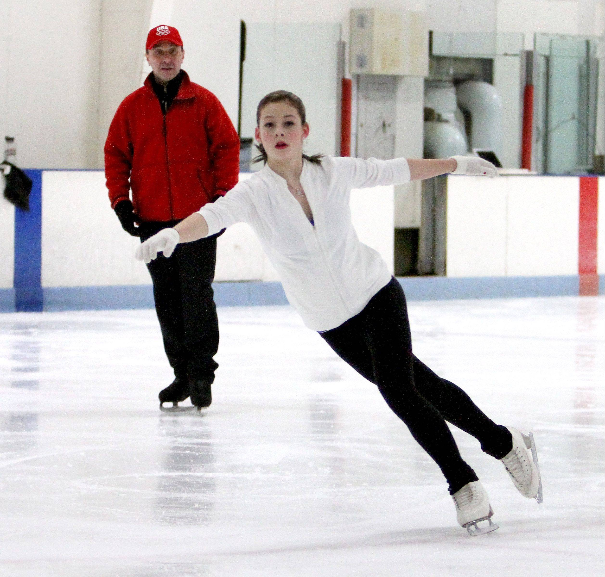 Gracie Gold trains at Center Ice of DuPage in Glen Ellyn in February 2012 as one of her coaches, Oleg Epstein, looks on.