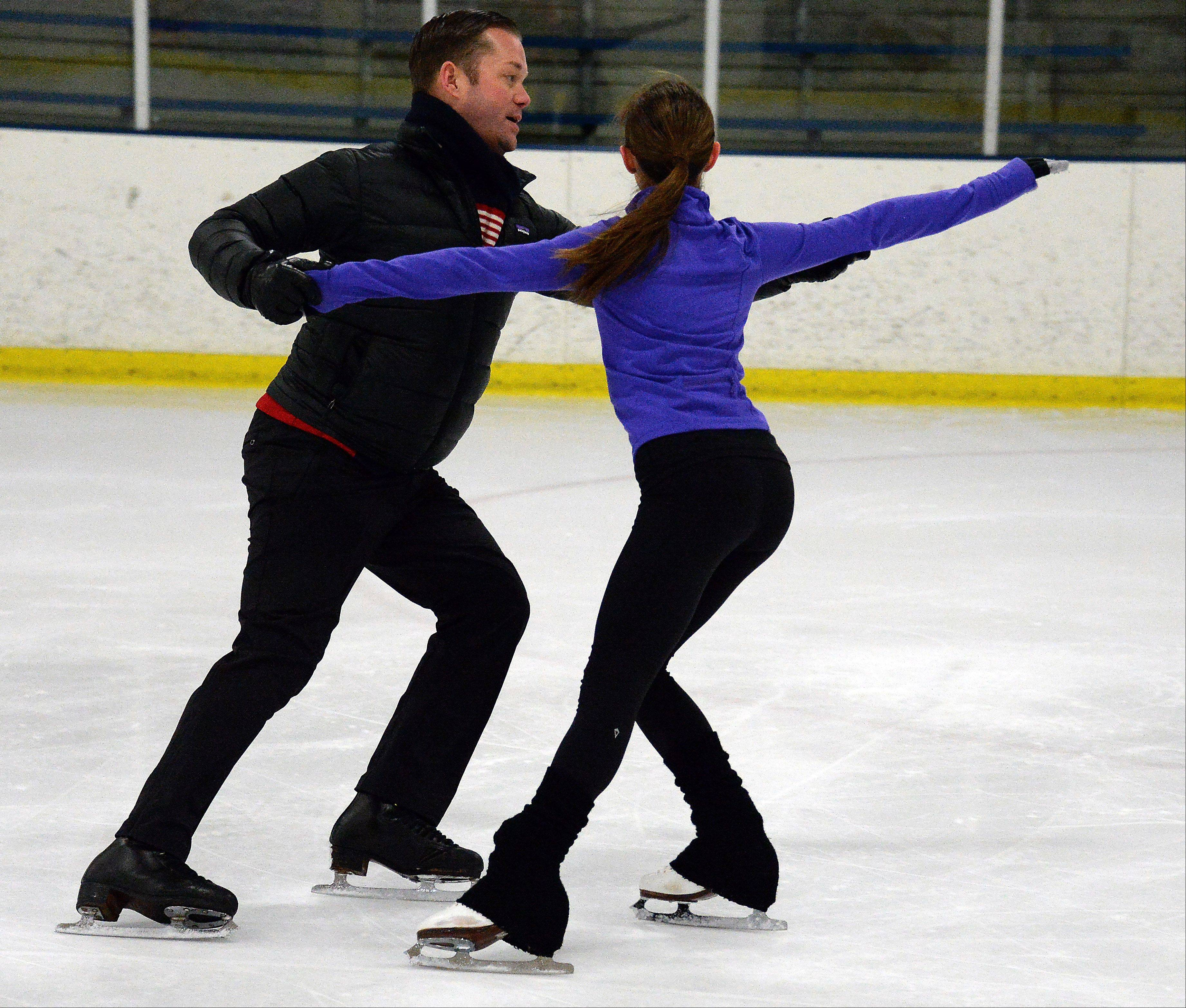 Scott Brown, a choreographer and coach for figure skater Gracie Gold, works with Megan Fee, 13, of Geneva last month at Twin Rinks in Buffalo Grove.