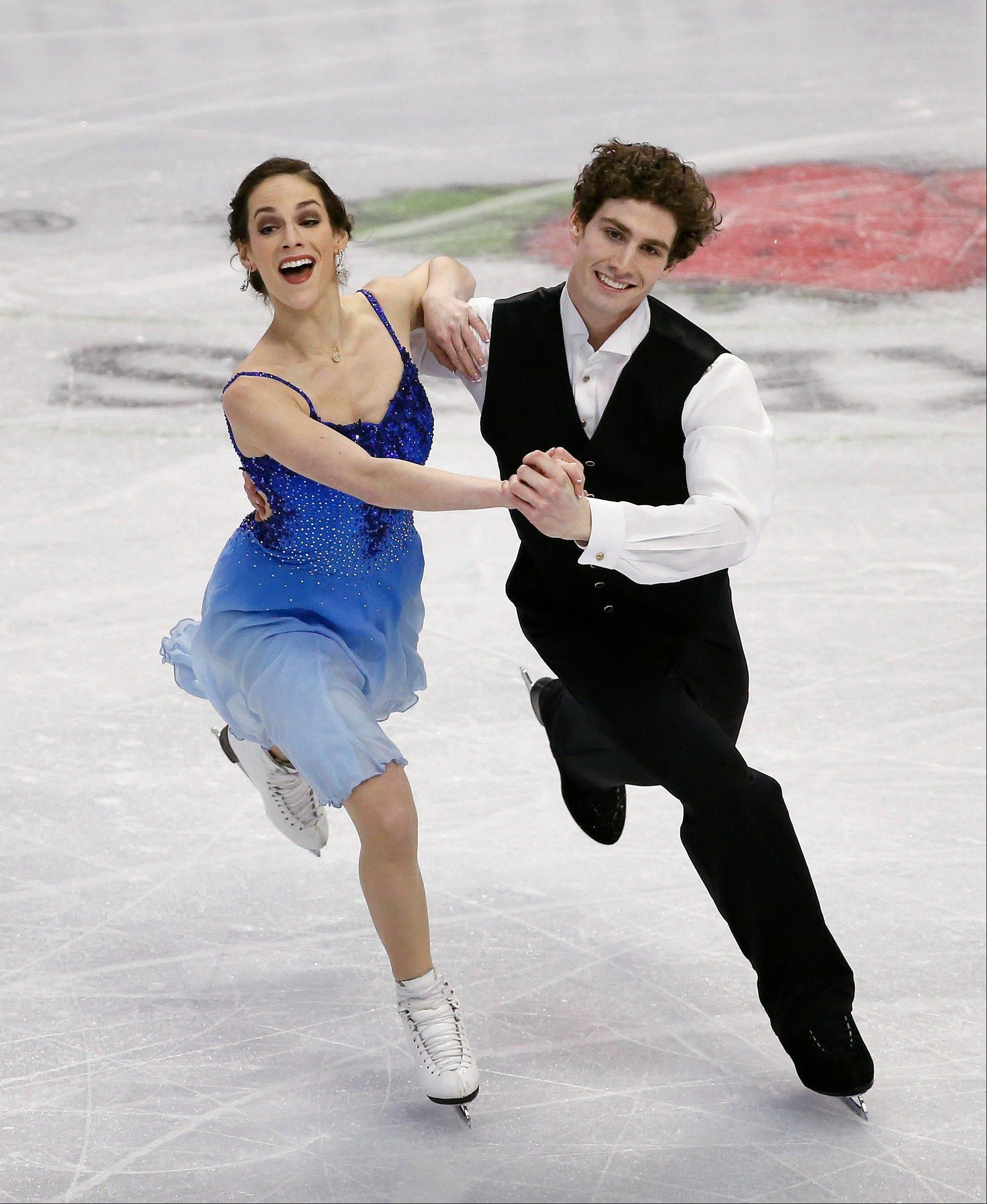 Collin Brubaker, 25, of Algonquin, skates with Alissandra Aronow earlier this year during the ice dancing short program at the U.S. Figure Skating Championships. Brubaker and his older brother Rockne train with several other elite skaters now competing at the Olympics.