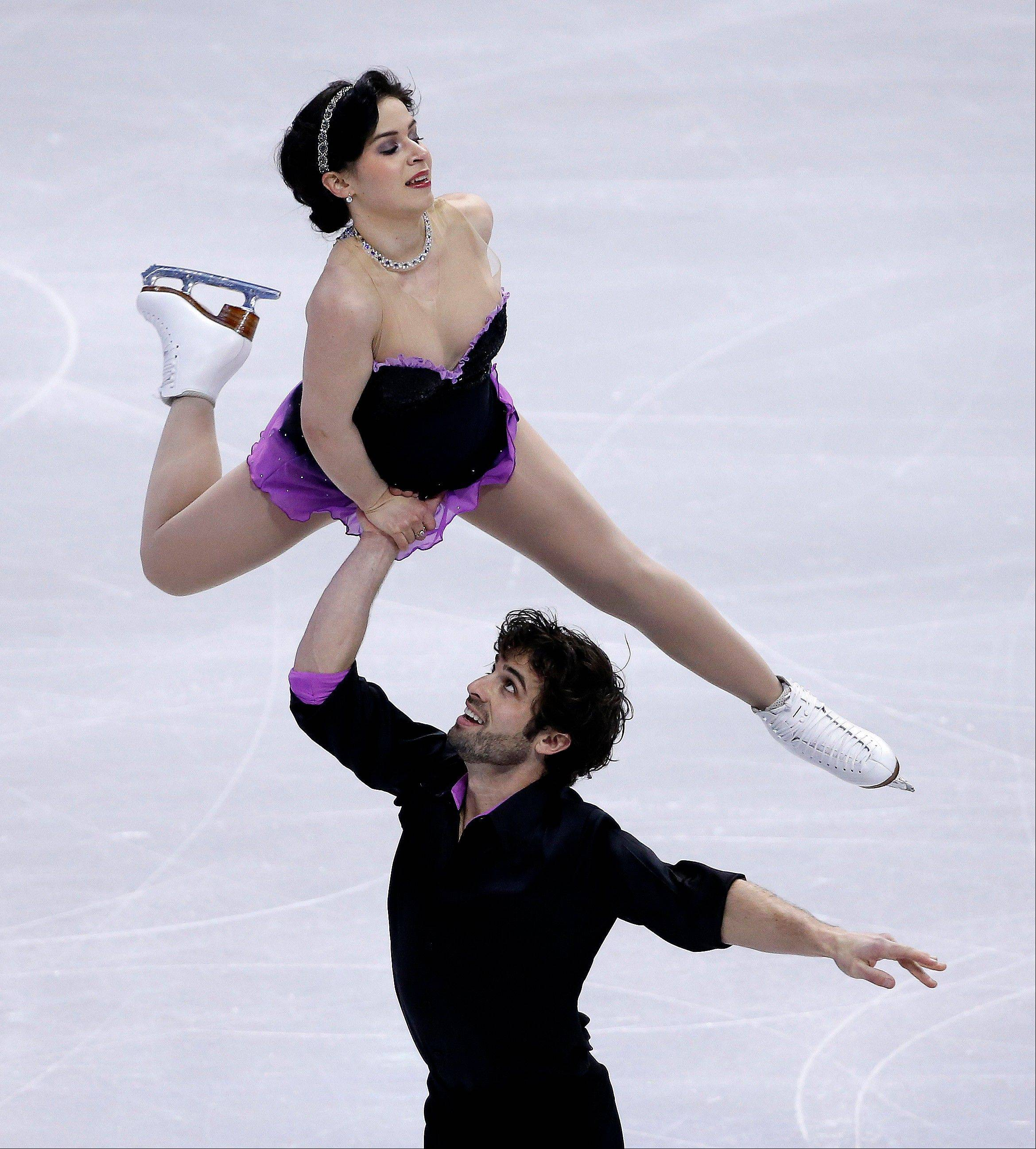 Rockne Brubaker, 27, of Algonquin, skates with Lindsay Davis during the pairs short program at the U.S. Figure Skating Championships last month. Brubaker and his younger brother Collin train with other elite skaters who are now at the Sochi Olympics.