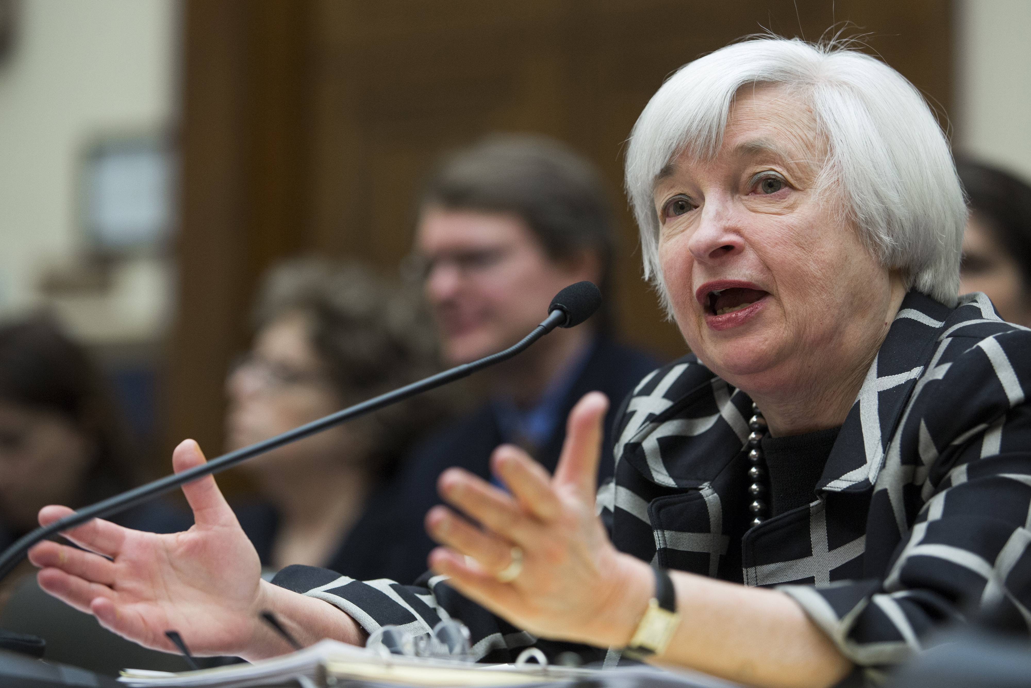 Janet Yellen, chairman of the Federal Reserve, delivers her semi-annual report on monetary policy and the outlook for the U.S. economy to the House Financial Services Committee in Washington on Tuesday. Yellen said more work is needed to restore the labor market to health and pledged to maintain her predecessor's policies to ensure a return to full employment and stable prices.