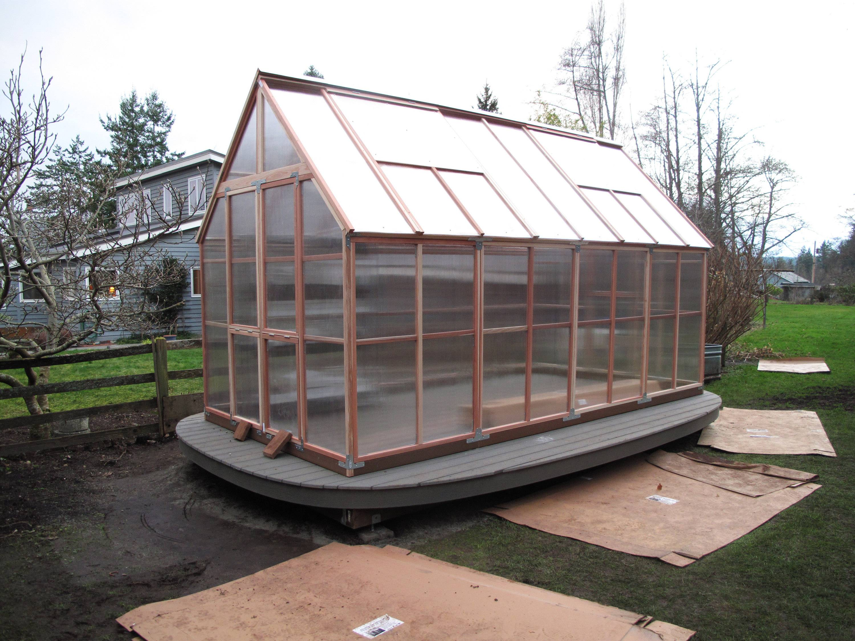 A new homeowner added a prebuilt Sunshine GardenHouse made from a kit to greatly extend the growing season in the cool coastal climate of Whidbey Island in Langley, Wash. It's being used for everything from seed starting and growing tomatoes and sweet corn to relaxing with a good book on days when it's too wet to garden.