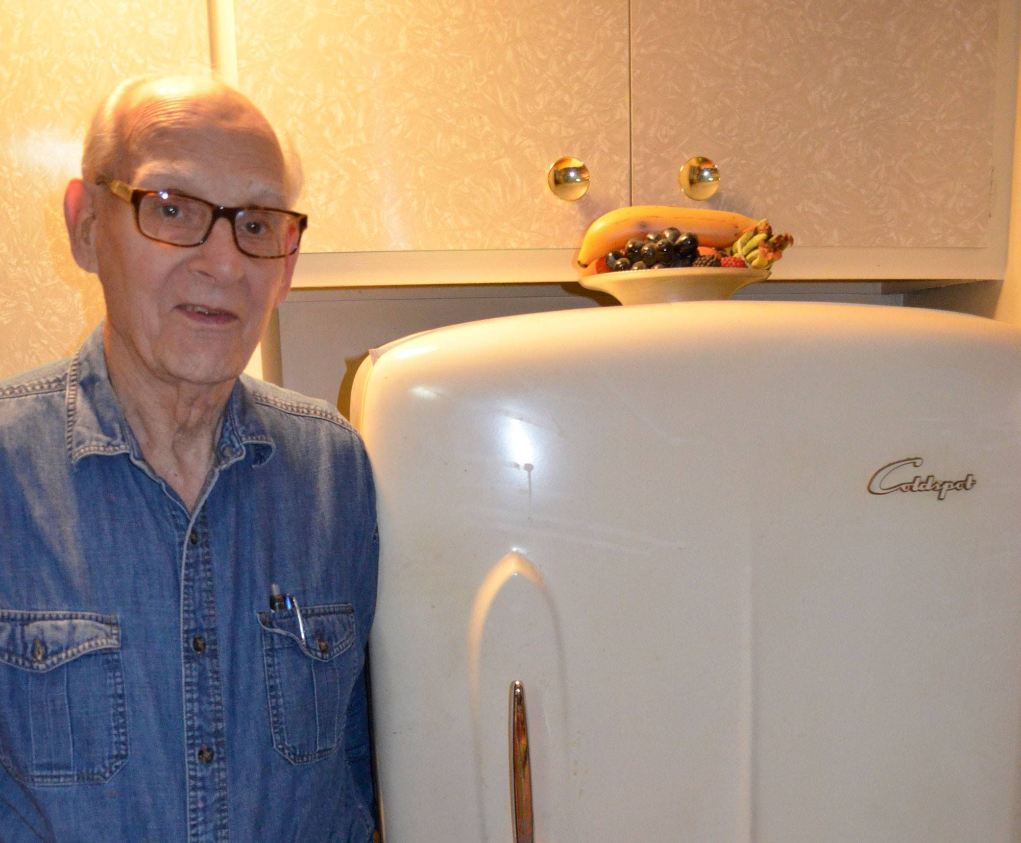 Stephanie Penick's dad, Don Crookston, with his prized 66-year-old Sears Roebuck Coldspot refrigerator.