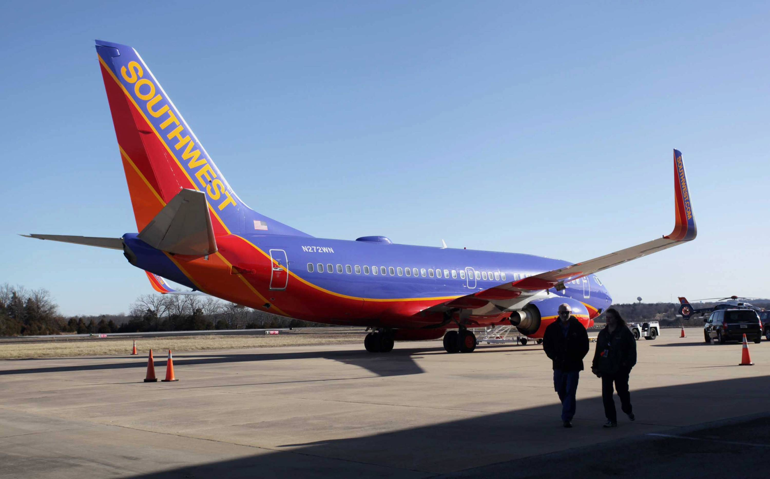Southwest Airlines Flight 4013 sits at the M. Graham Clark Downtown Airport in Hollister, Mo., in this Jan. 13, 2014 file photo. On nearly 150 flights, U.S. commercial air carriers have either landed at the wrong airport or started to land and realized their mistake in time, according to a search by The Associated Press of government safety databases and media reports since the early 1990s.