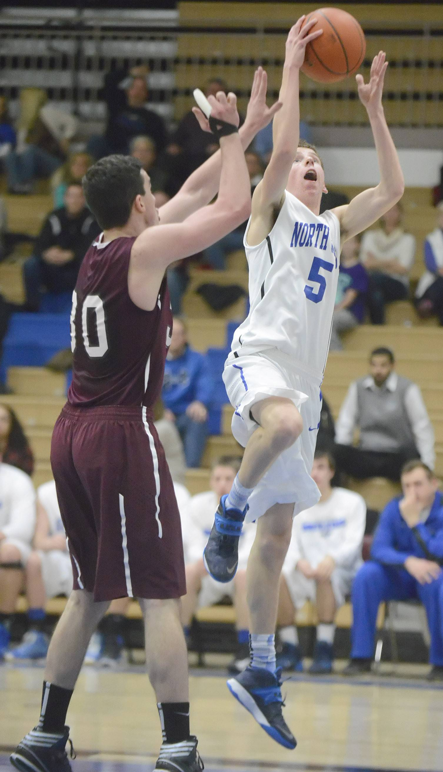 Elgin's Kiko Mari tries to block St. Charles North's Tyler DeMoss in the fourth quarter on Tuesday, February 11.