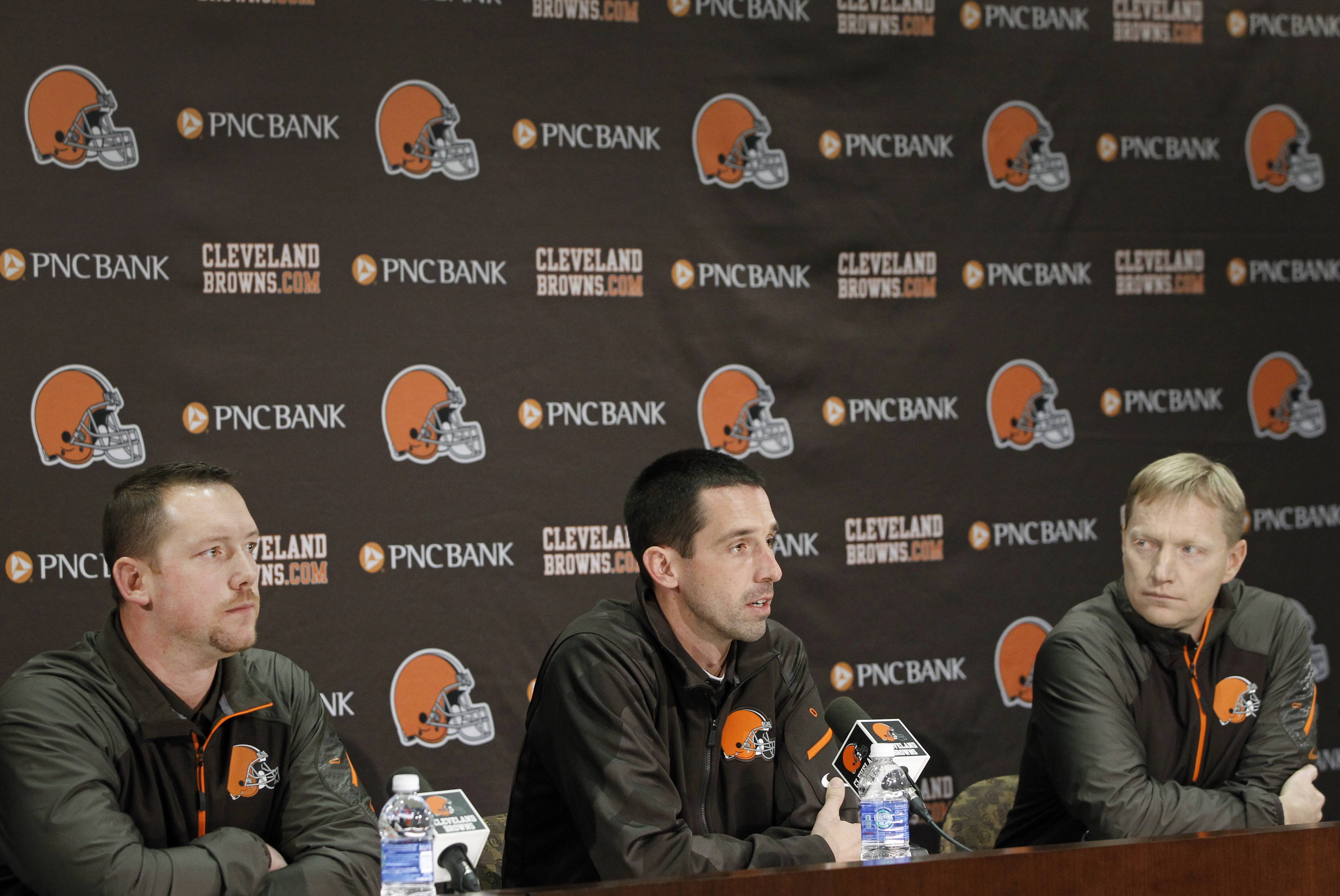 From left to right, Cleveland Browns defensive coordinator Jim O'Neil, offensive coordinator Kyle Shanahan and special teams coordinator Chris Tabor answer questions during an NFL football news conference on Thursday, Feb. 6, 2014, at the team's training facility in Berea, Ohio. (AP Photo/The Plain Dealer, Lonnie Timmons III) MANDATORY CREDIT; NO SALES