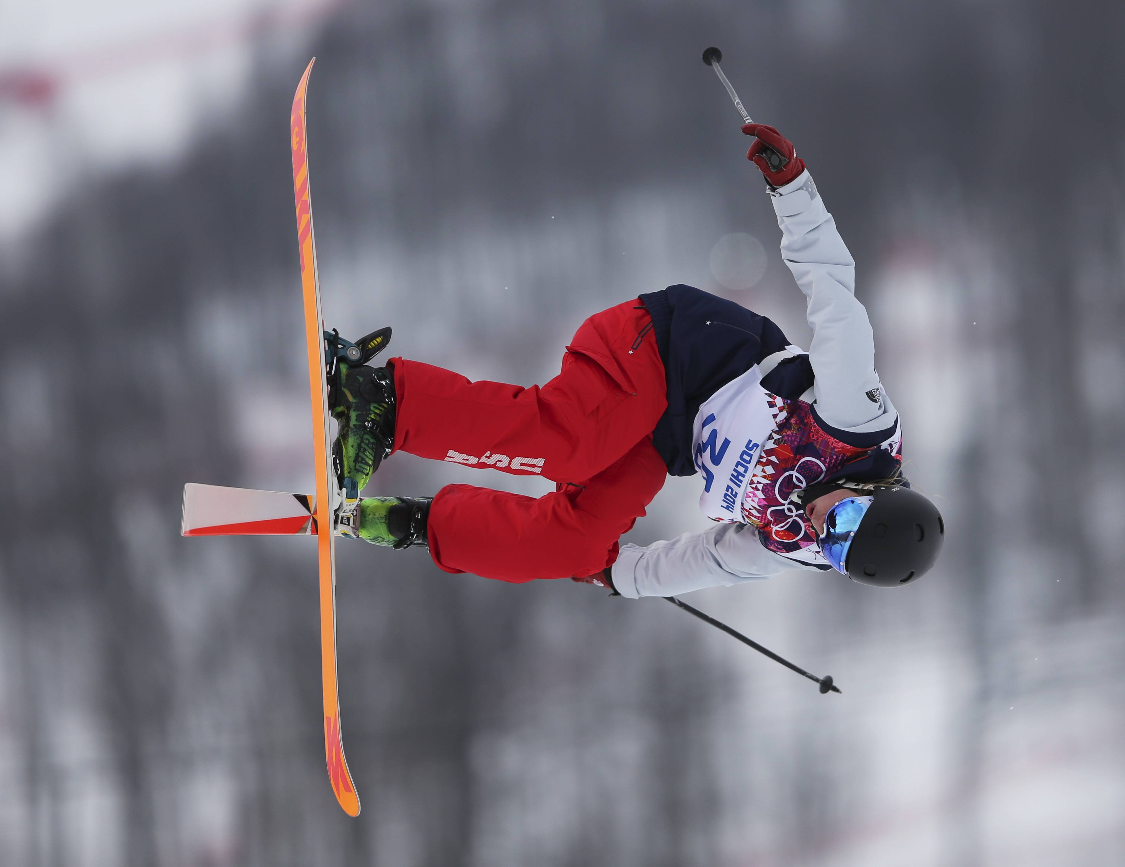 Julia Krass of the United States takes a jump during the women's freestyle skiing slopestyle qualifying.