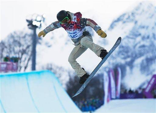 Shaun White of the United States competes during the men's snowboard halfpipe qualifying session at the Rosa Khutor Extreme Park, at the 2014 Winter Olympics, Tuesday, Feb. 11, 2014, in Krasnaya Polyana, Russia.
