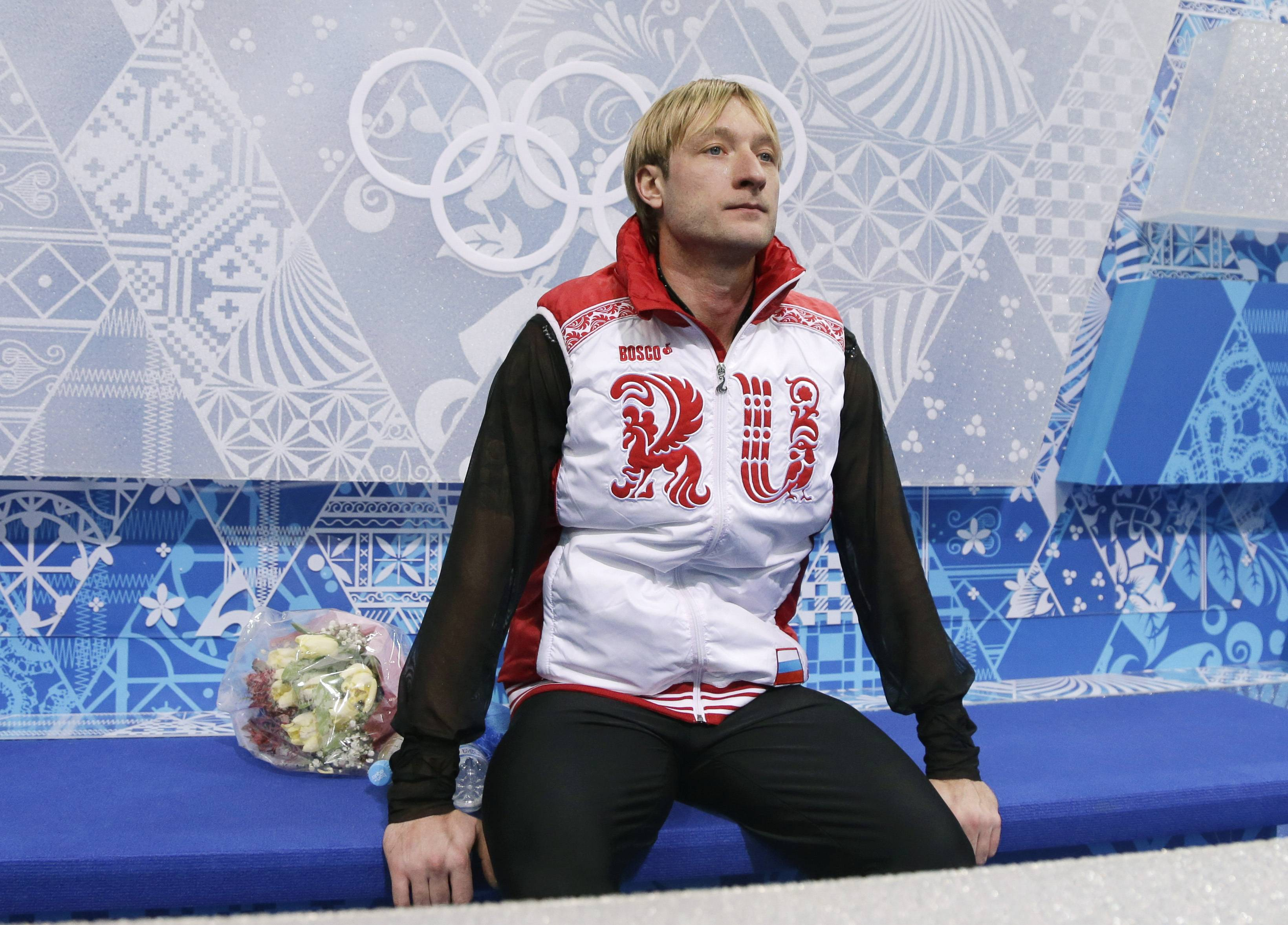 Evgeni Plushenko of Russia sits Sunday after competing in the men's team free skate figure skating competition at the Iceberg Skating Palace during the 2014 Winter Olympics in Sochi, Russia.