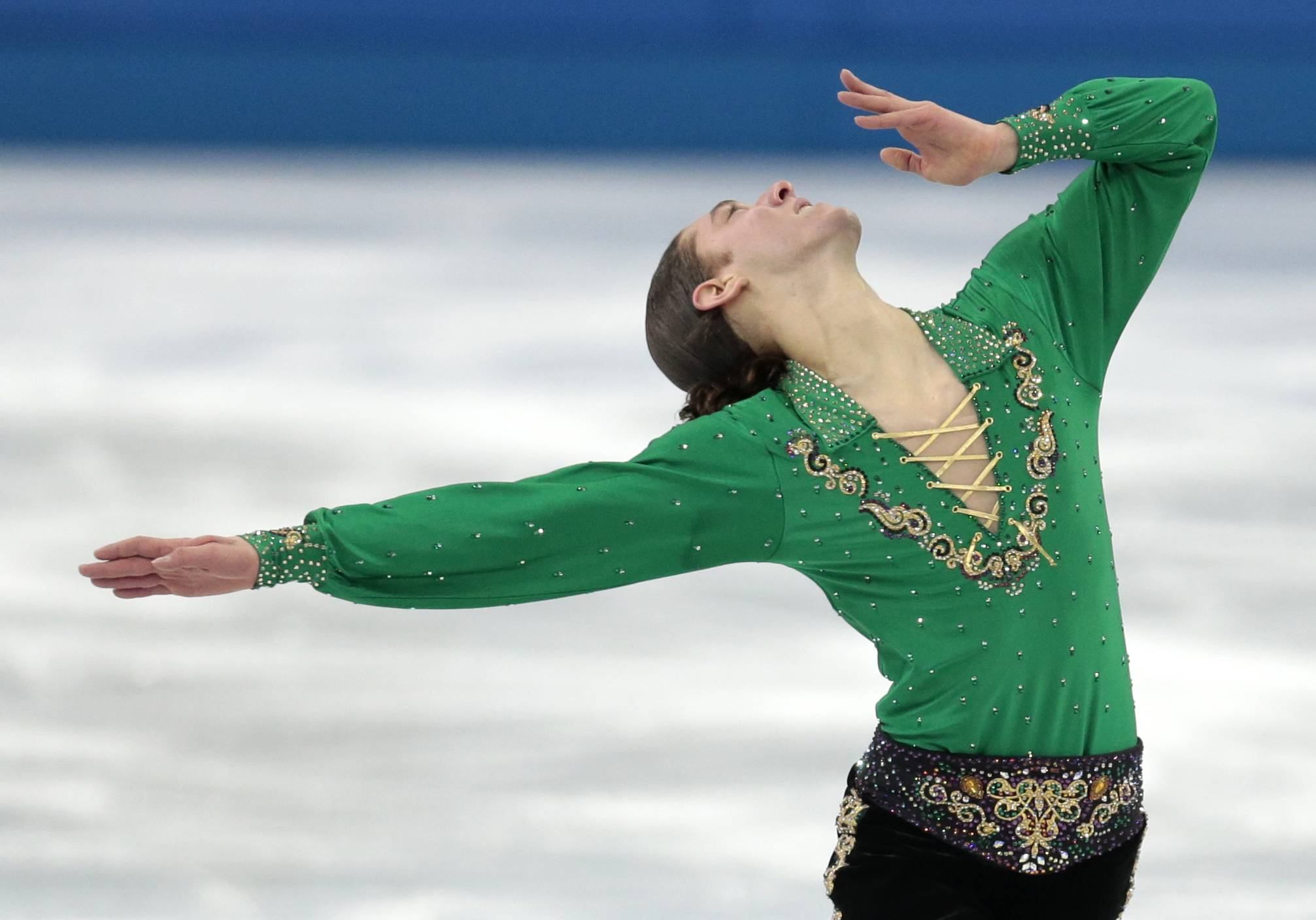 Jason Brown of the United States competes in the men's team free skate figure skating competition Sunday.