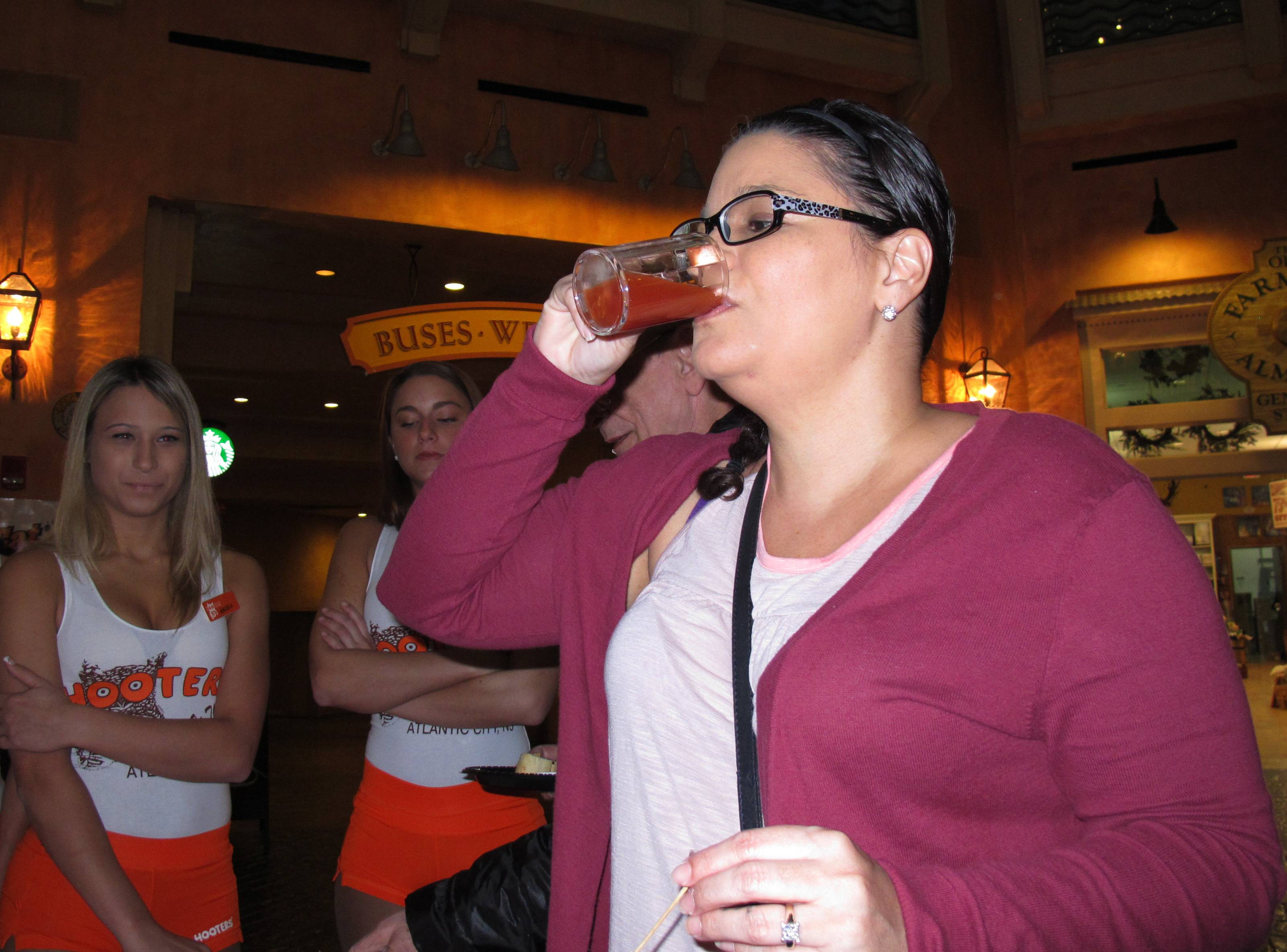 Nadina Fornia, of Egg Harbor Township, N.J., tastes a Bloody Mary mixed with bacon-flavored beer at the Tropicana Casino and resort in Atlantic City.
