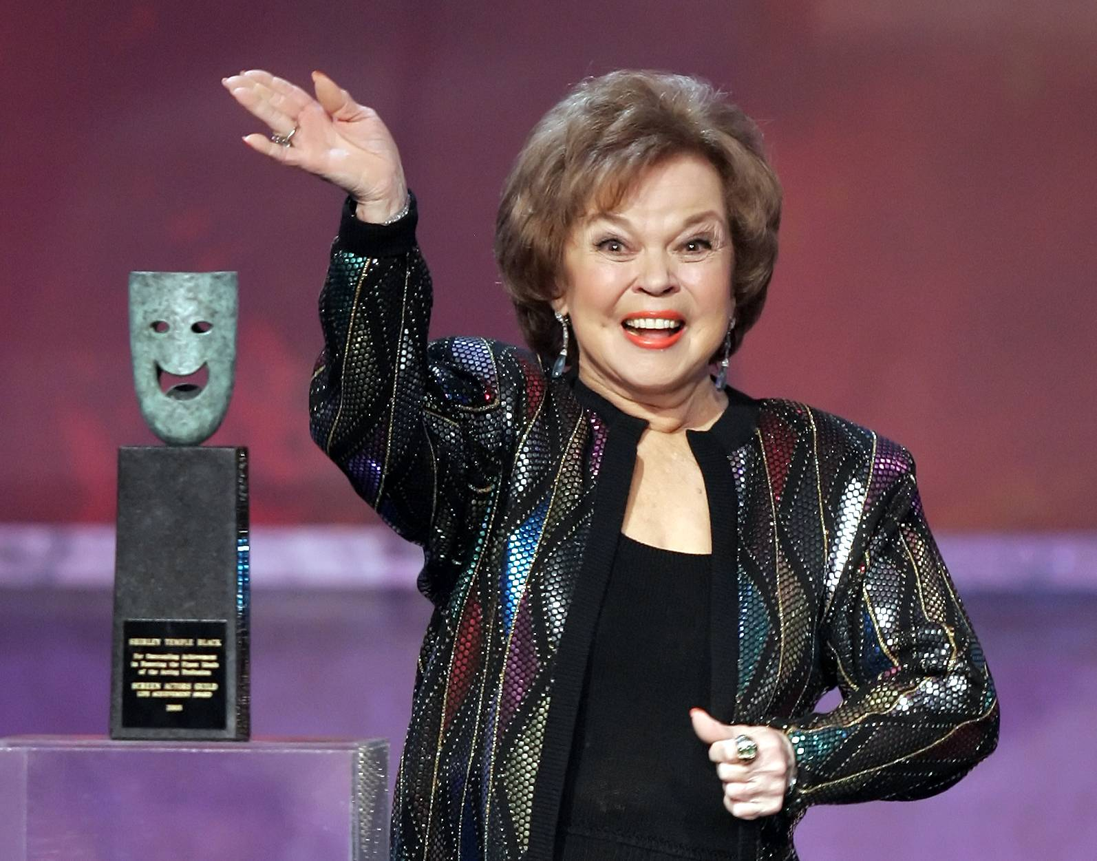 Shirley Temple Black accepts the Screen Actors Guild Awards life achievement award at the 12th Annual Screen Actors Guild Awards, in Los Angeles. Temple, the curly-haired child star who put smiles on the faces of Depression-era moviegoers, has died. She was 85.