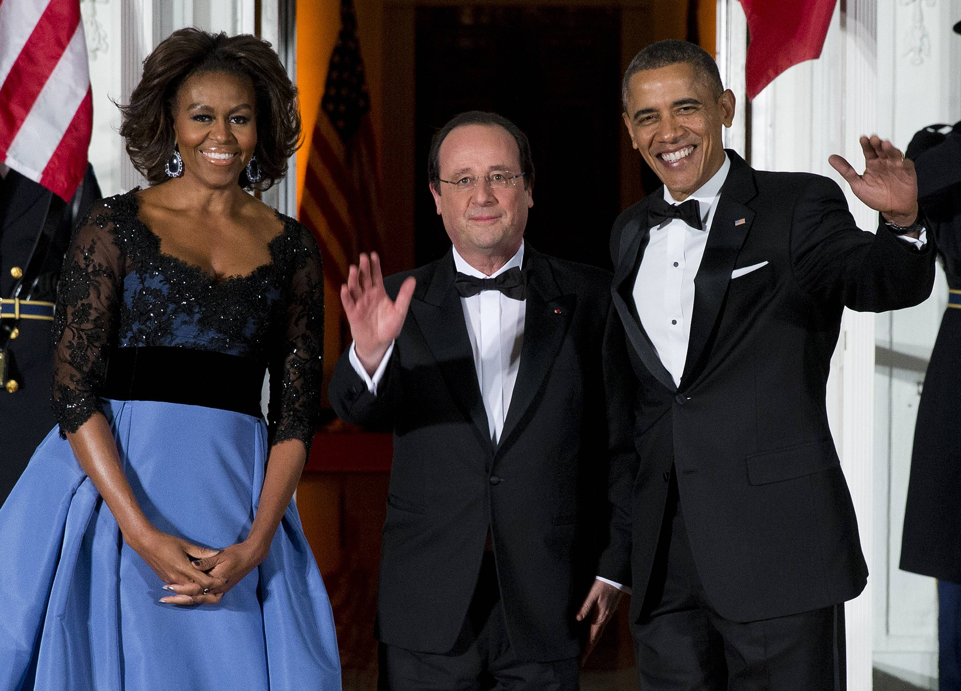 First lady Michelle Obama, left, and President Barack Obama welcome French President François Hollande for a State Dinner at the North Portico of the White House on Tuesday.