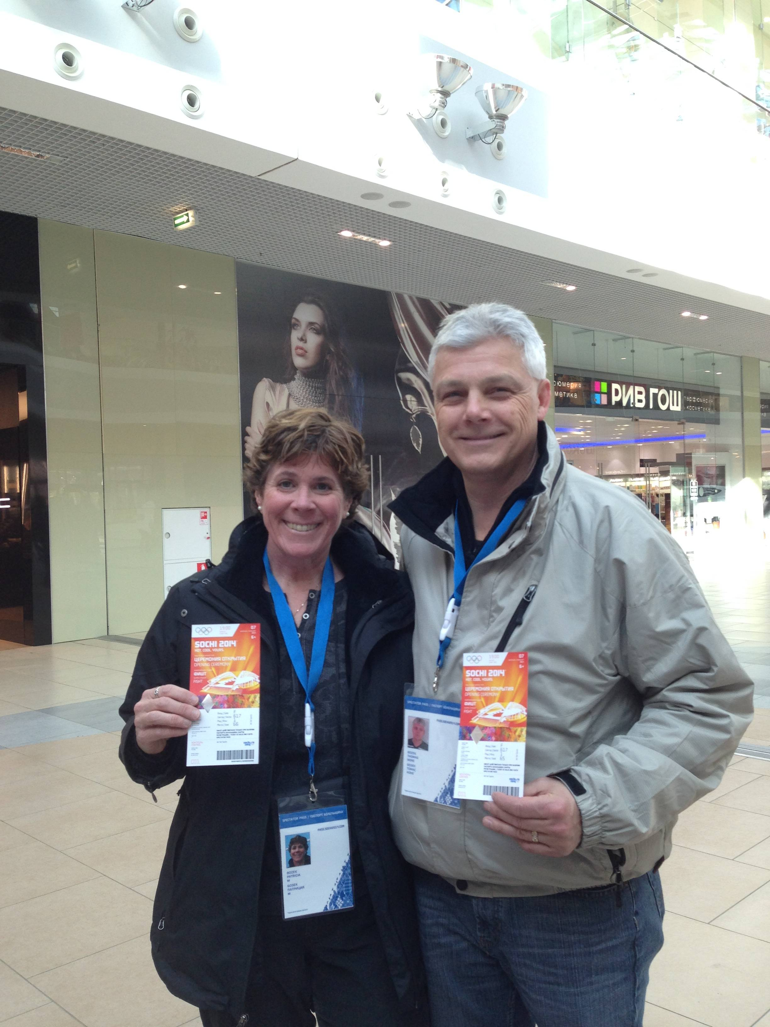 Patti and Tom Bozek of Buffalo Grove show their passes at the Olympic Games in Sochi, where they are cheering on daughter Megan, a U.S. women's hockey team player.