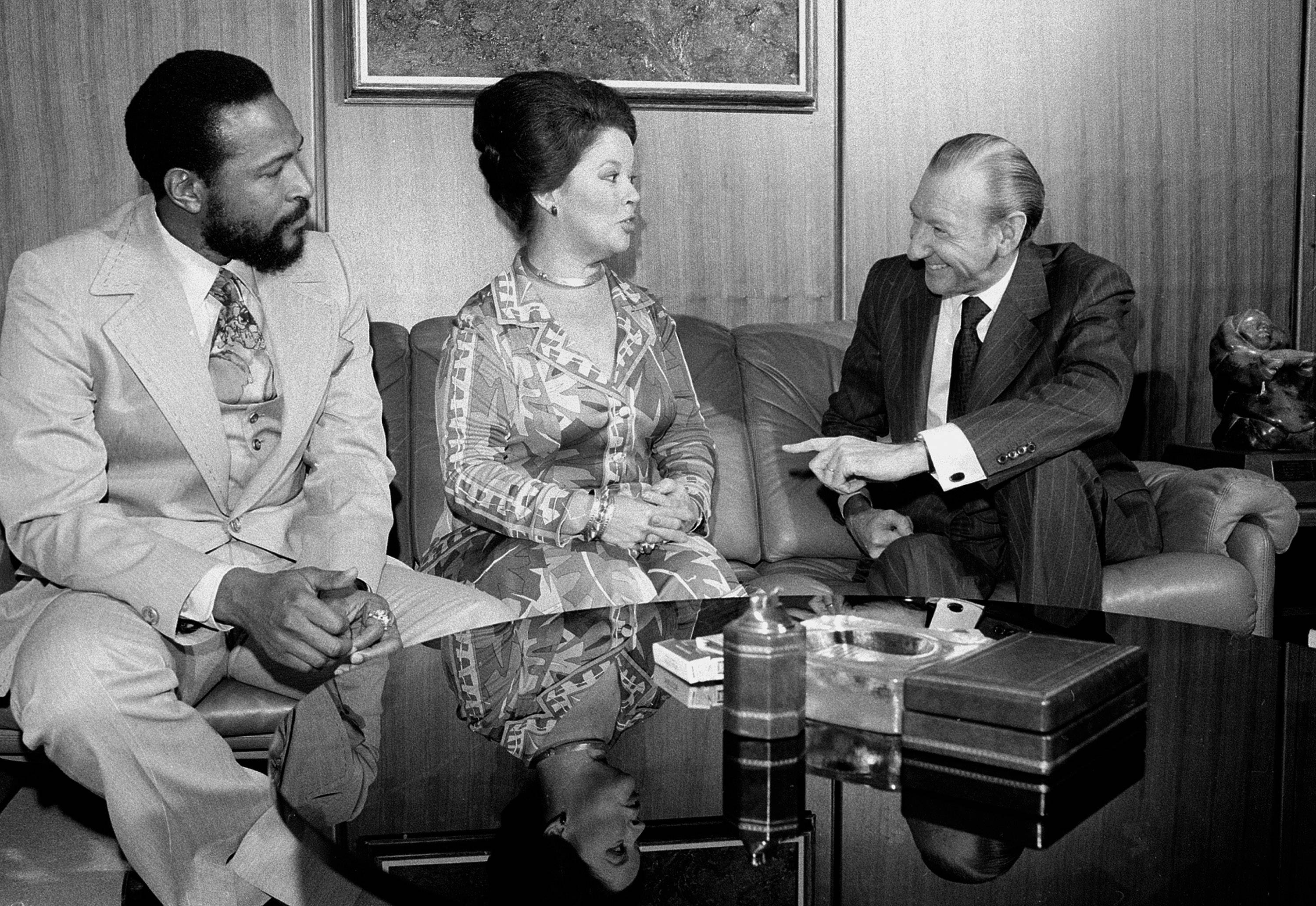 In this Monday, Oct. 13, 1975, file photo, singer-songwriter Marvin Gaye, left, sits with United Nations Secretary-General Kurt Waldheim, right, and Shirley Temple Black, U.S. Ambassador to Ghana, at the United Nations.