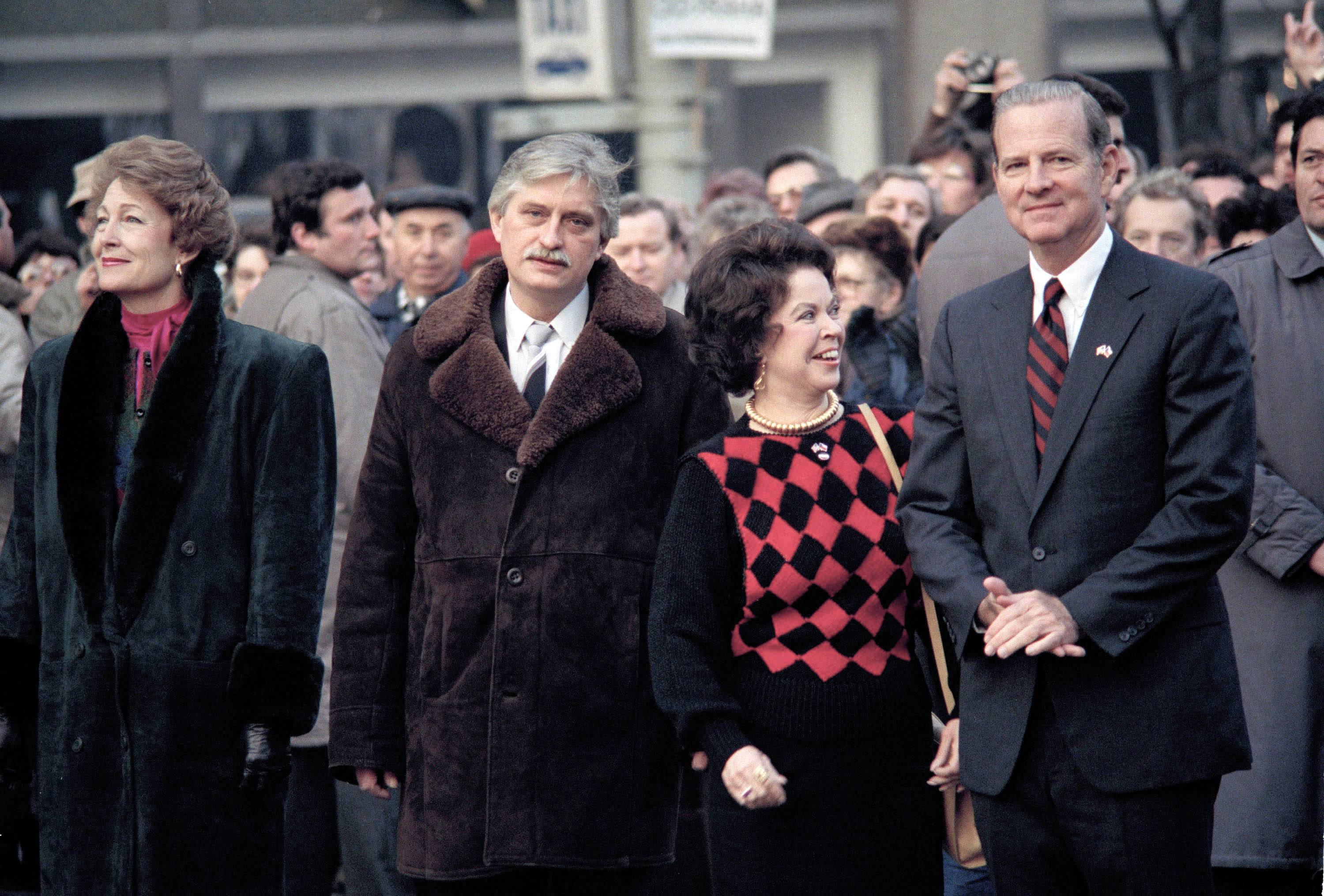 In this Feb. 7, 1990, file photo, U.S. Ambassador to Czechoslovakia Shirley Temple Black, second from right, talks to U.S. Secretary of State James Baker during a ceremony at the Wenceslas Square in Prague, in memory of Czech student Jan Palach who self-immolated in protest against the Soviet invasion.