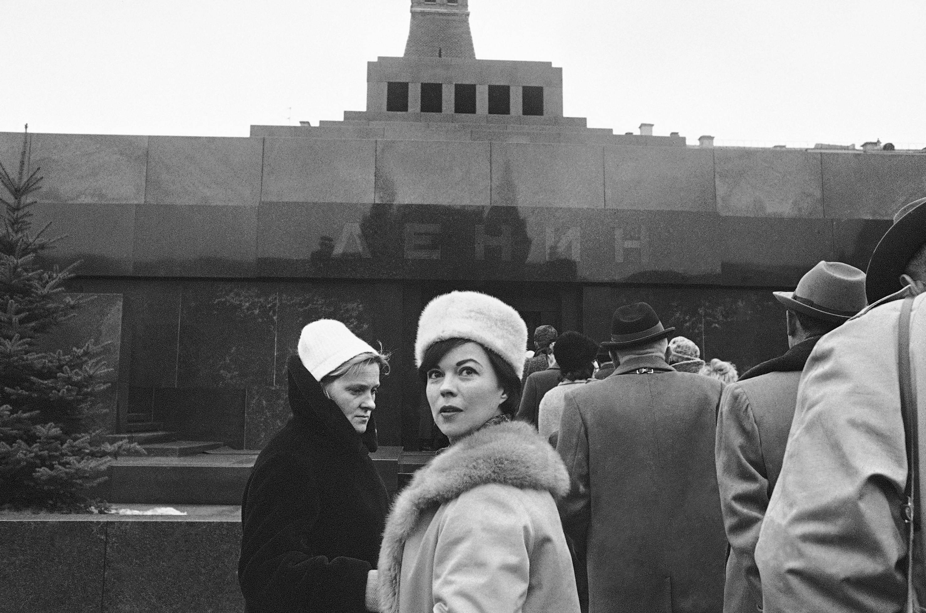 In this March 21, 1965, file photo, Shirley Temple, former child film star, waits in the line to visit Lenin's tomb in Red Square, in Moscow. Temple was in Moscow to consult Russian neurologists about her brother, who has multiple sclerosis.