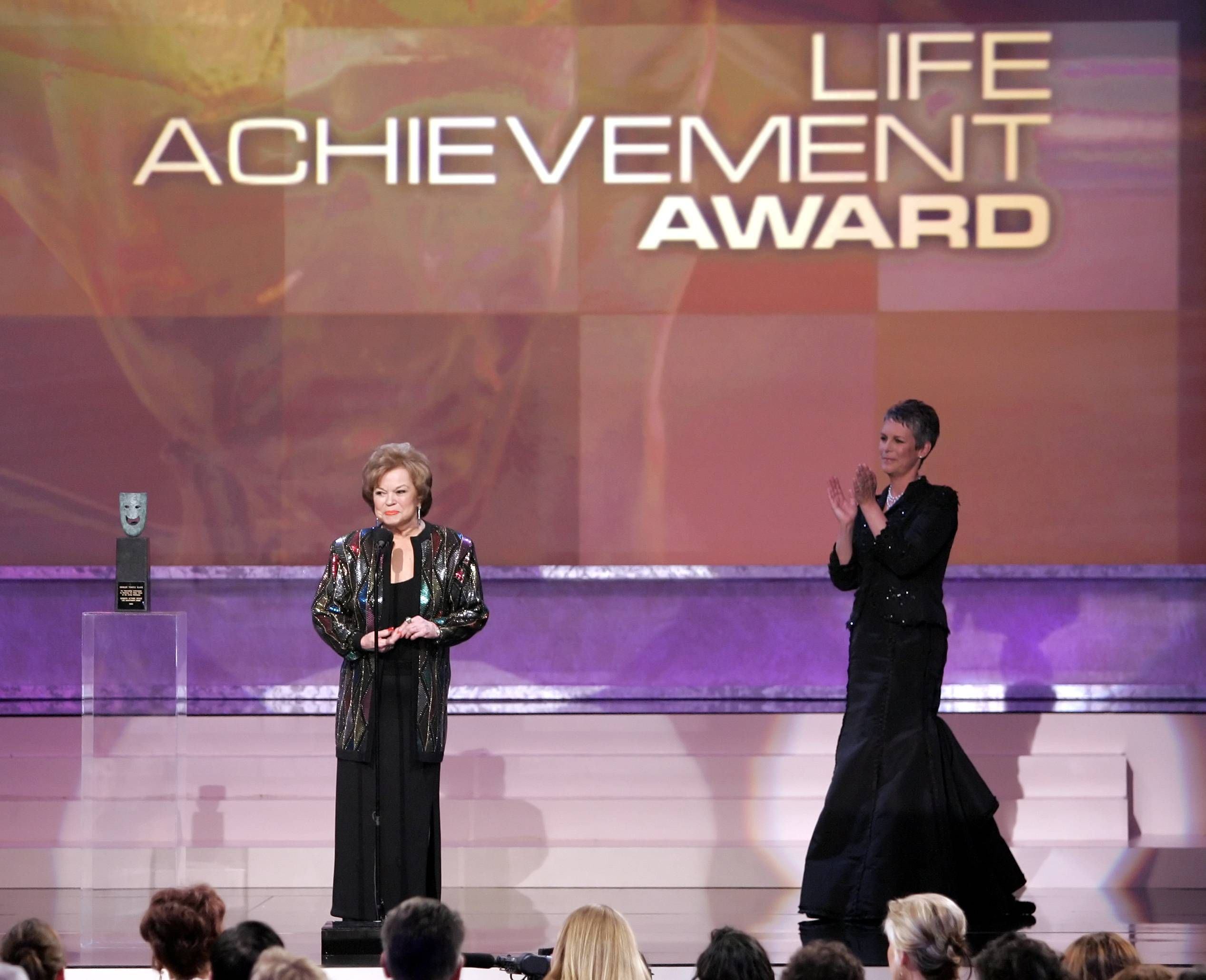 In this Sunday, Jan. 29, 2006, file photo, Jamie Lee Curtis, right, applauds as Shirley Temple Black accepts the Screen Actors Guild Awards annual Life Achievement Award at the Annual Screen Actors Guild Awards, in Los Angeles.