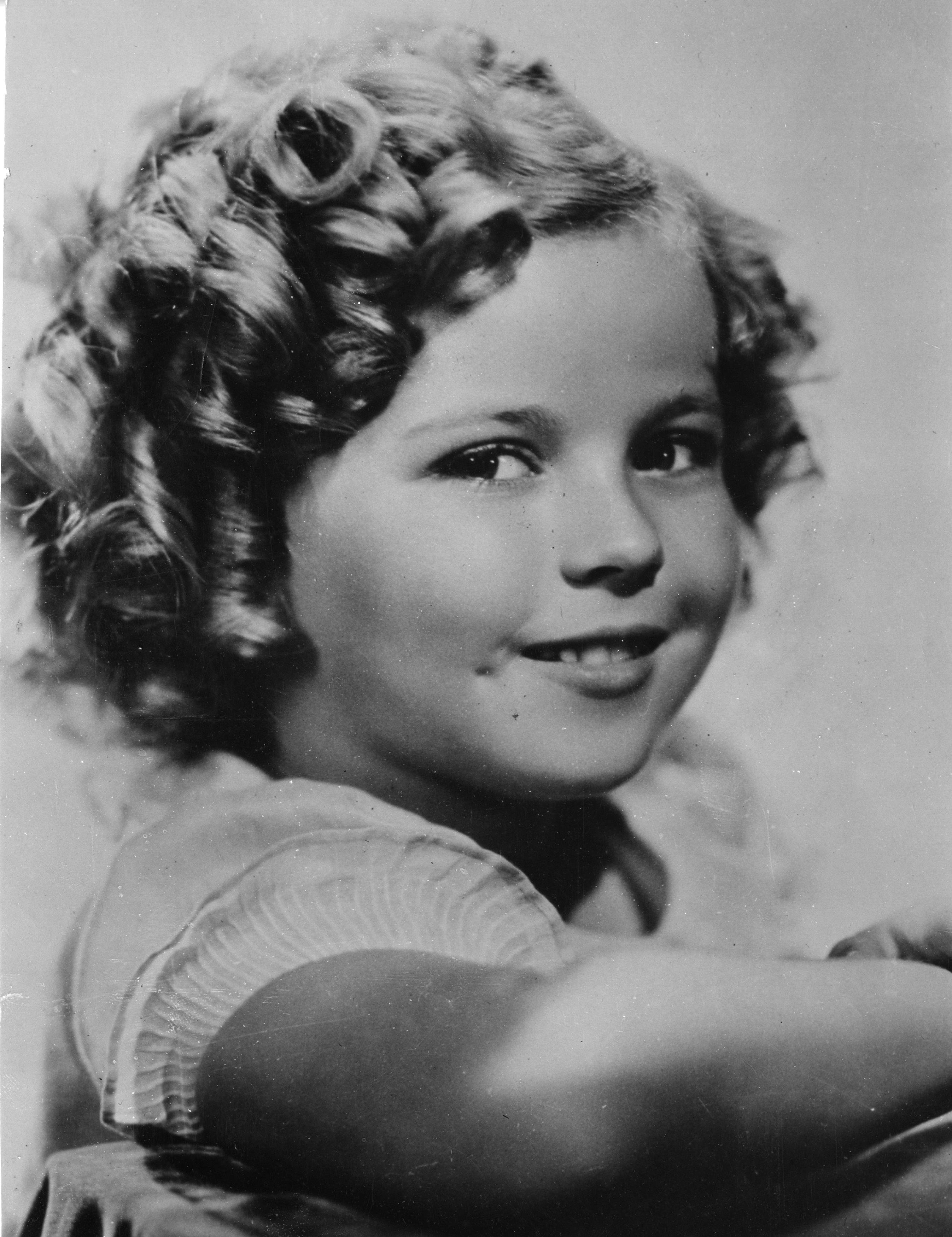 In this Nov. 1936 file photo, 8-year-old U.S. American child movie star Shirley Temple is portrayed in Hollywood, Ca.