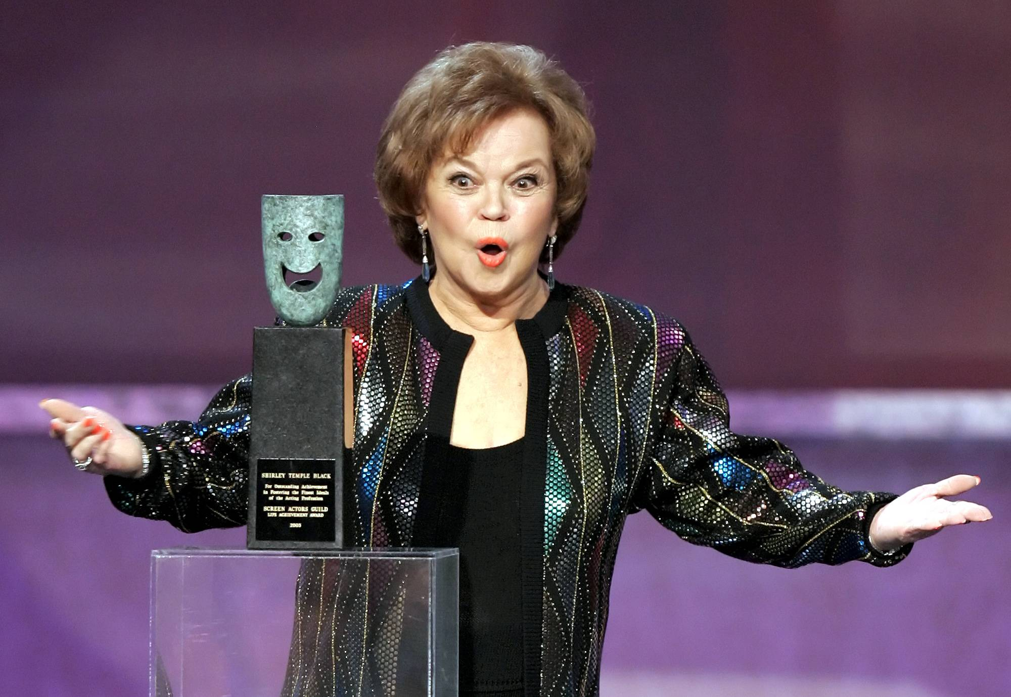 In this Jan. 29, 2006 file photo, Shirley Temple Black accepts the Screen Actors Guild Awards life achievement award at the 12th Annual Screen Actors Guild Awards, in Los Angeles.