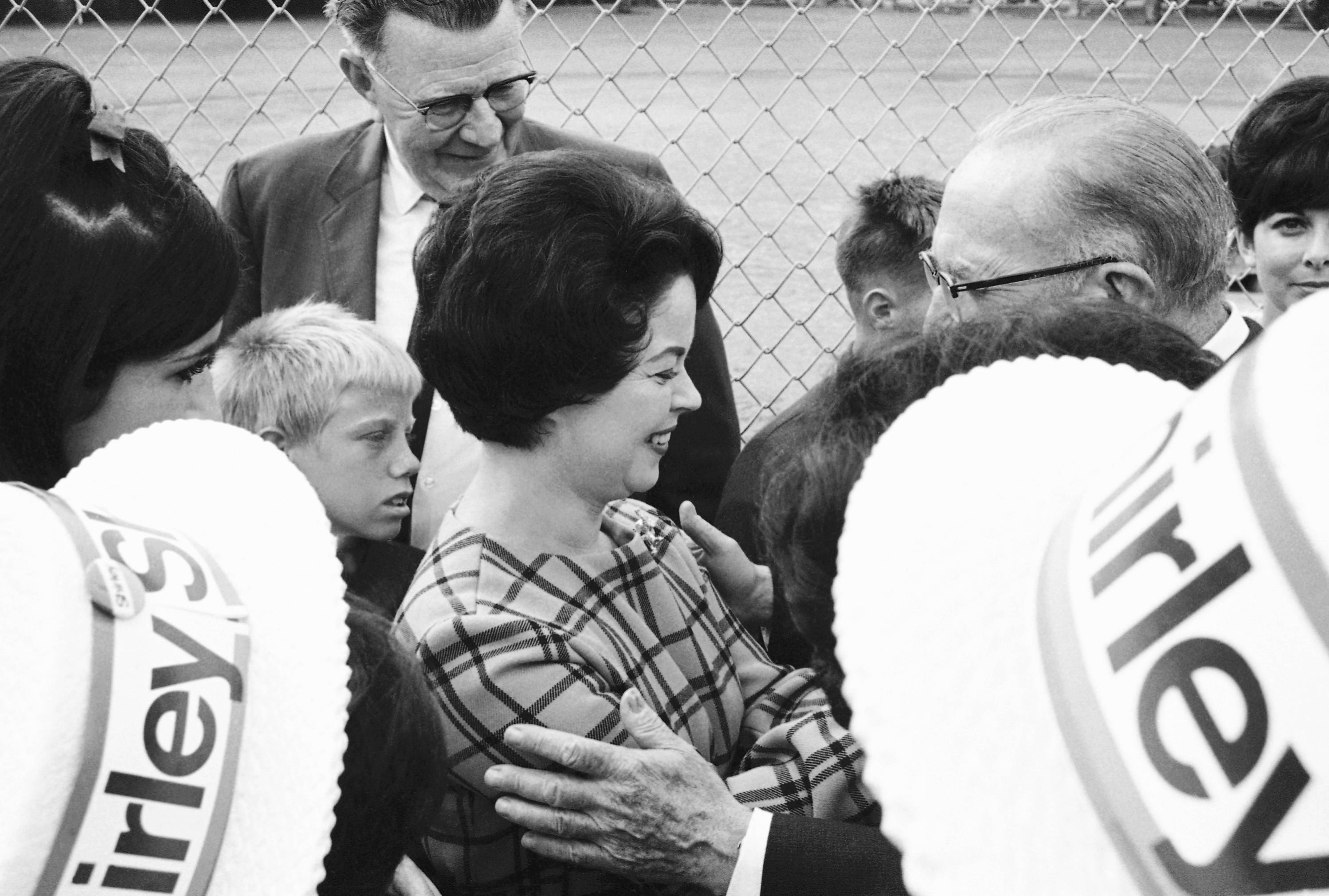 In this Oct. 21, 1967, file photo, Shirley Temple Black, on the campaign trial for the U.S. Senate, was the center of attention as she moved through a public park and talked with people of her district in San Mateo, Calif.