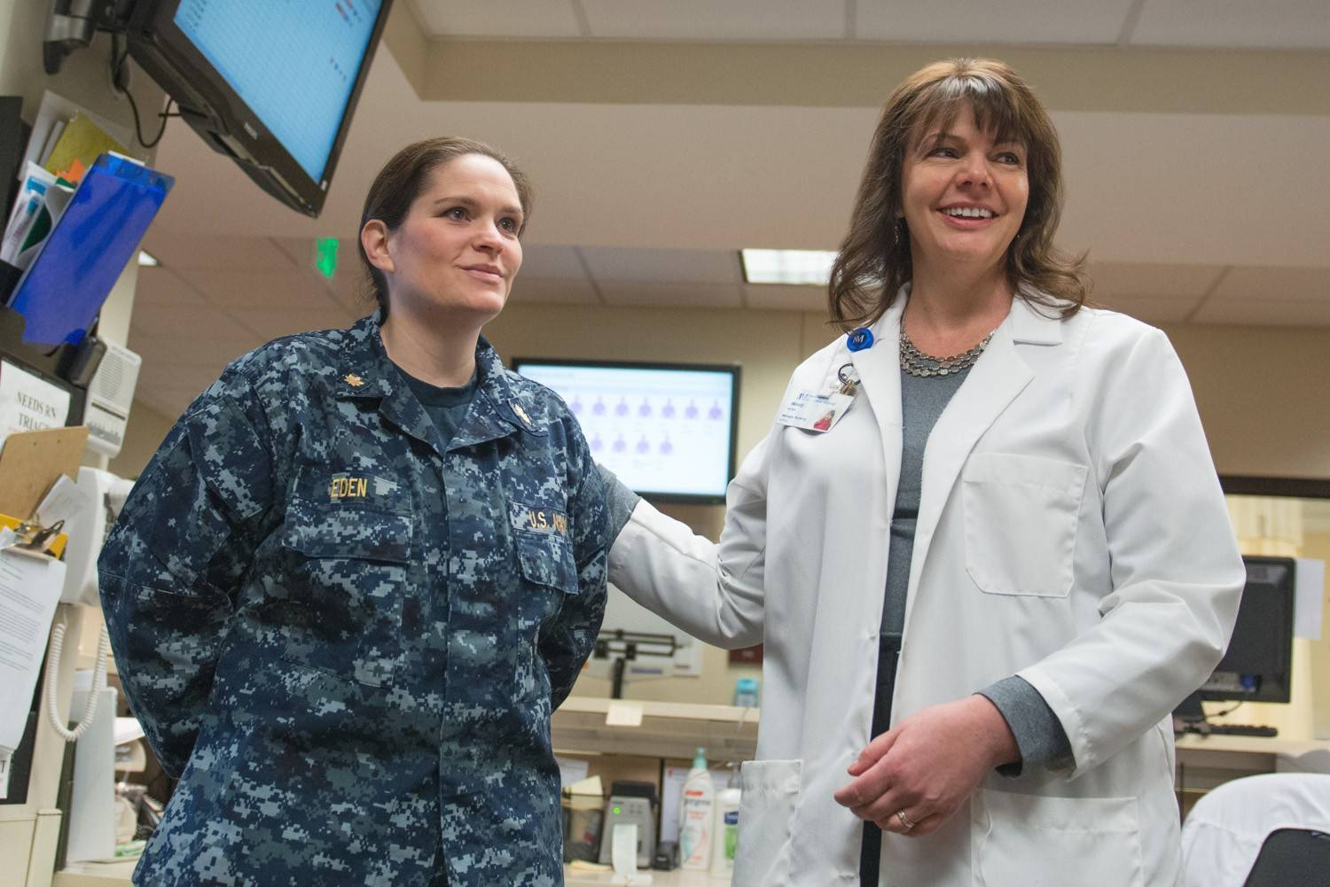 U.S. Naval Reserves Lt. Cmdr. Tabitha Eden, a registered nurse at Northwestern Grayslake Emergency Center, with her boss, Nursing Supervisor Wendy Callan. For her support of Eden's military service in the workplace, Callan recently received the Patriot Award.