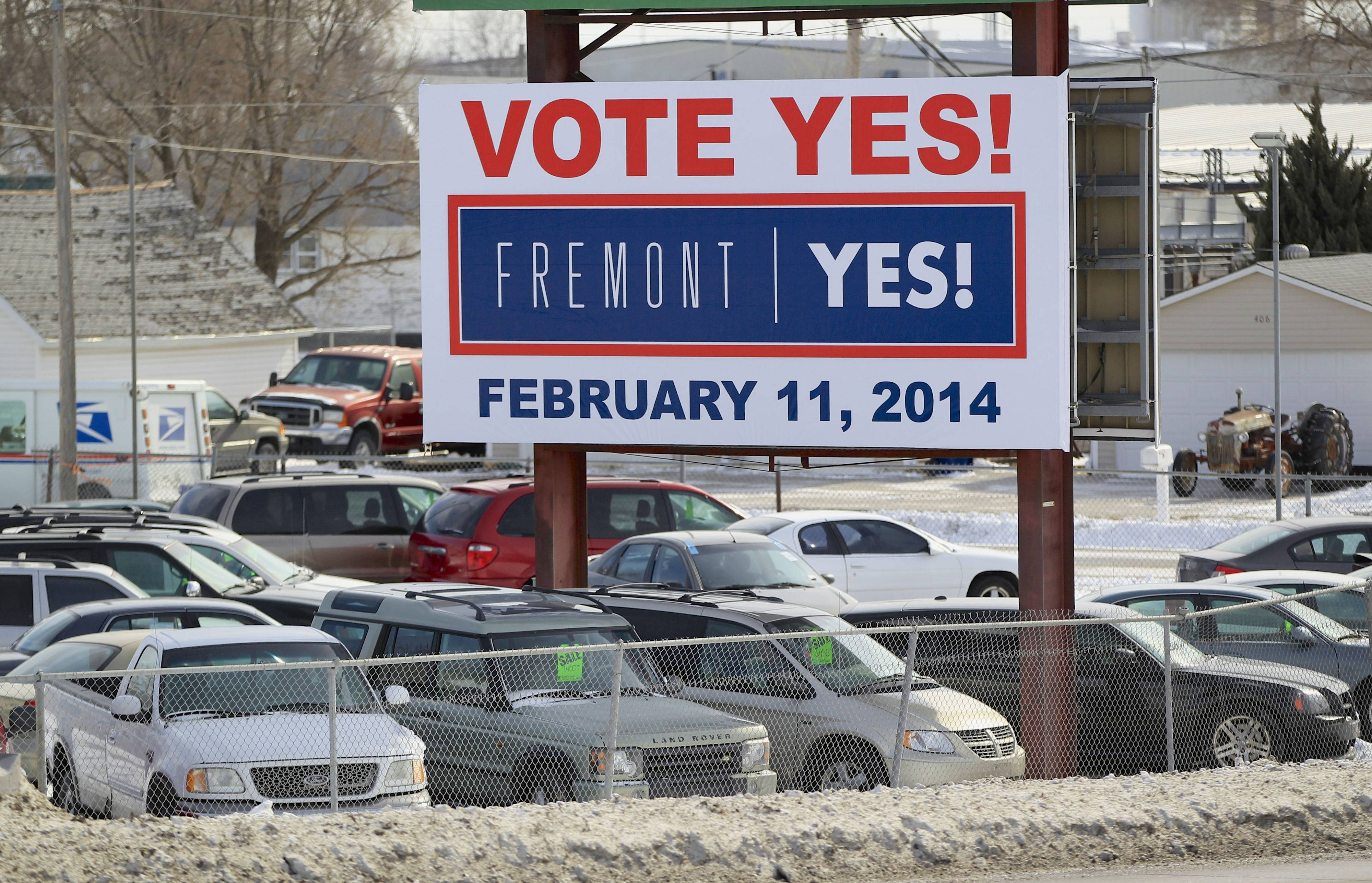 "A billboard urging voters to vote ""Yes"" stands in Fremont, Neb. Voters in the eastern Nebraska city of Fremont will decide in a special election on Tuesday, Feb. 11, whether to drop housing restrictions aimed at reducing illegal immigration they had approved in 2010."