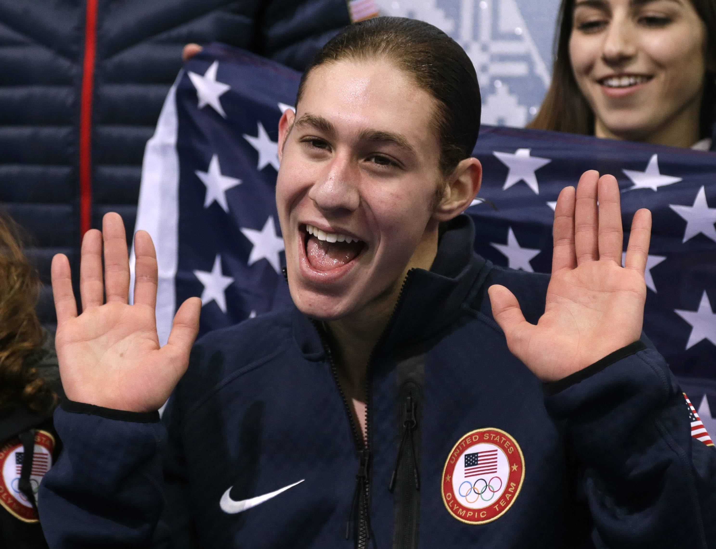 Jason Brown of the United States waves to spectators after competing in the men's team free skate figure skating competition Sunday at the Iceberg Skating Palace during the 2014 Winter Olympics.