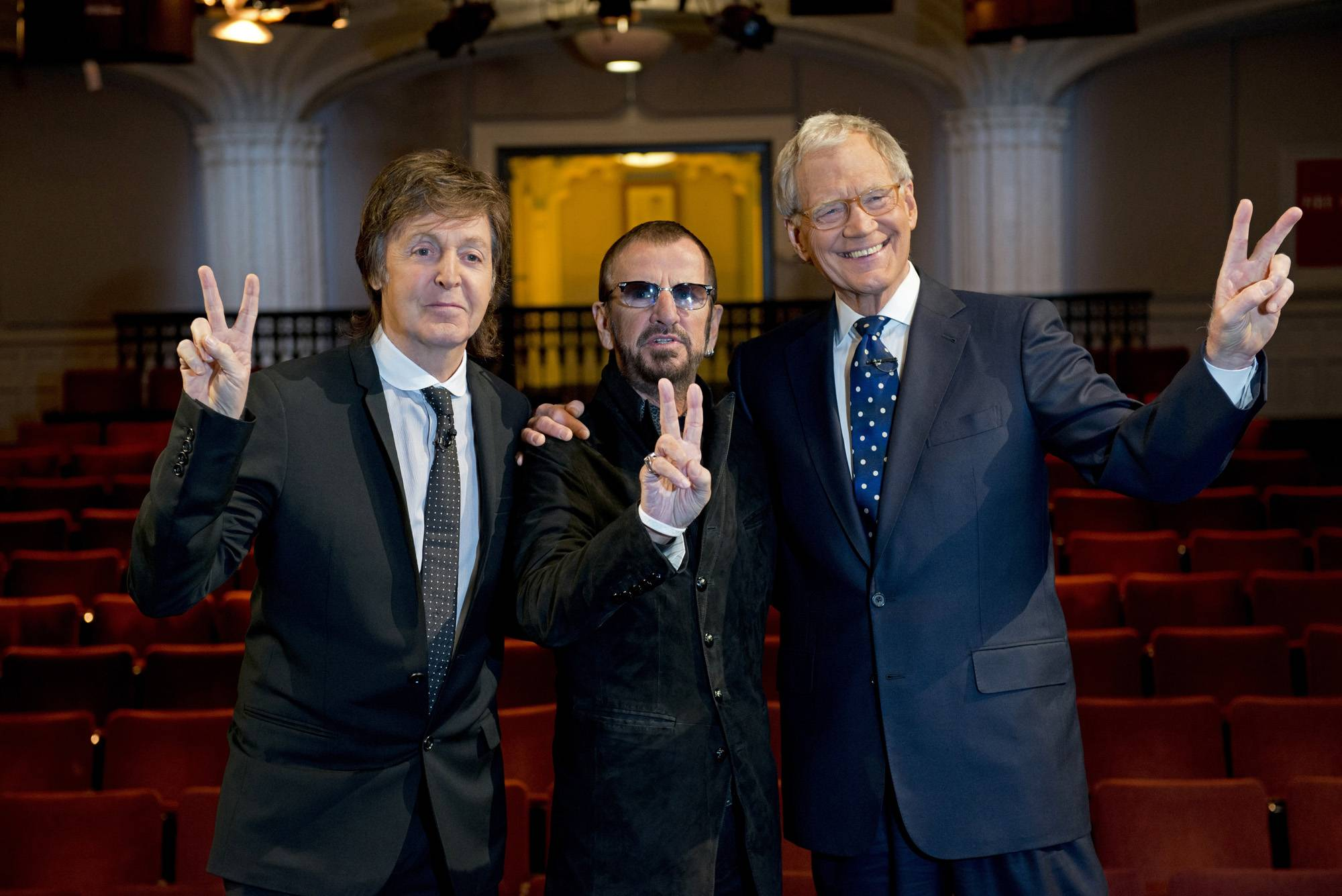 "In an TV interview featured in ""The Beatles: The Night That Changed America -- A Grammy Salute,"" former Beatles Paul McCartney, left, and Ringo Starr, center, pose for a photo with talk show host David Letterman in the Ed Sullivan Theater in New York."