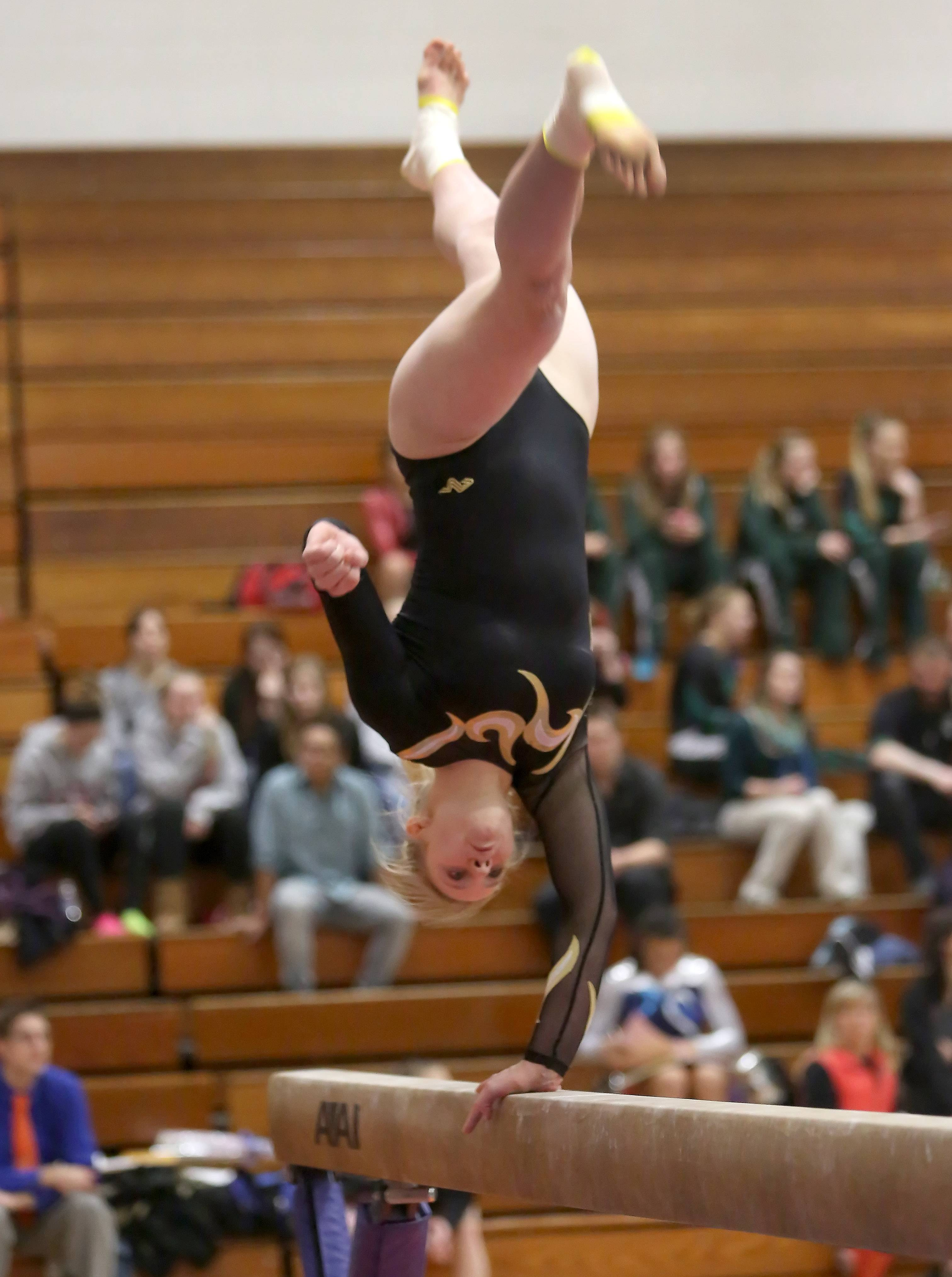 Allison Wahrman of Glenbard North performs her beam routine during gymnastics sectional at Wheaton Warrenville South on Tuesday in Wheaton.