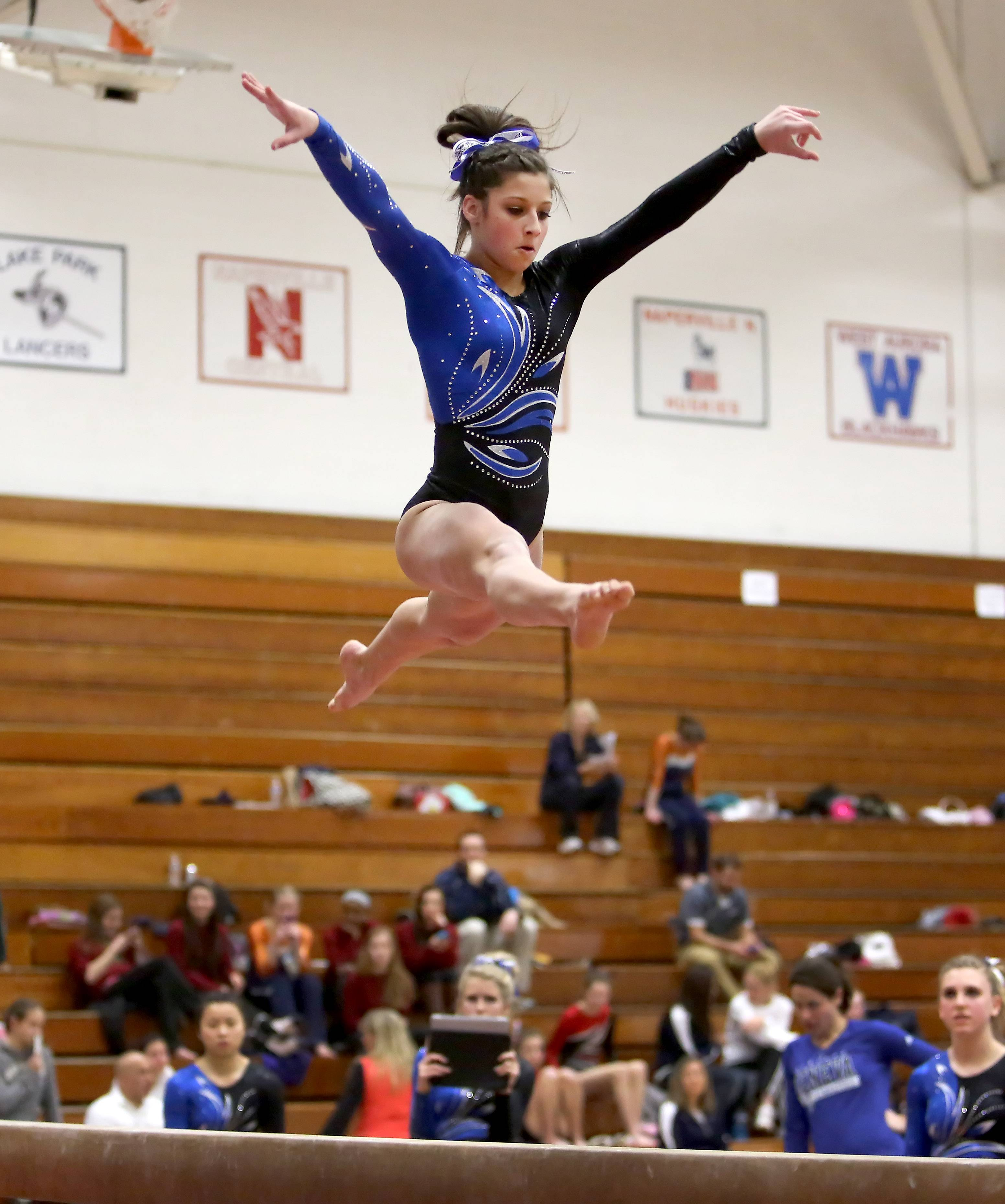 Claire Rose Ginsberg of Geneva performs on the beam during gymnastics sectional at Wheaton Warrenville South on Tuesday in Wheaton.