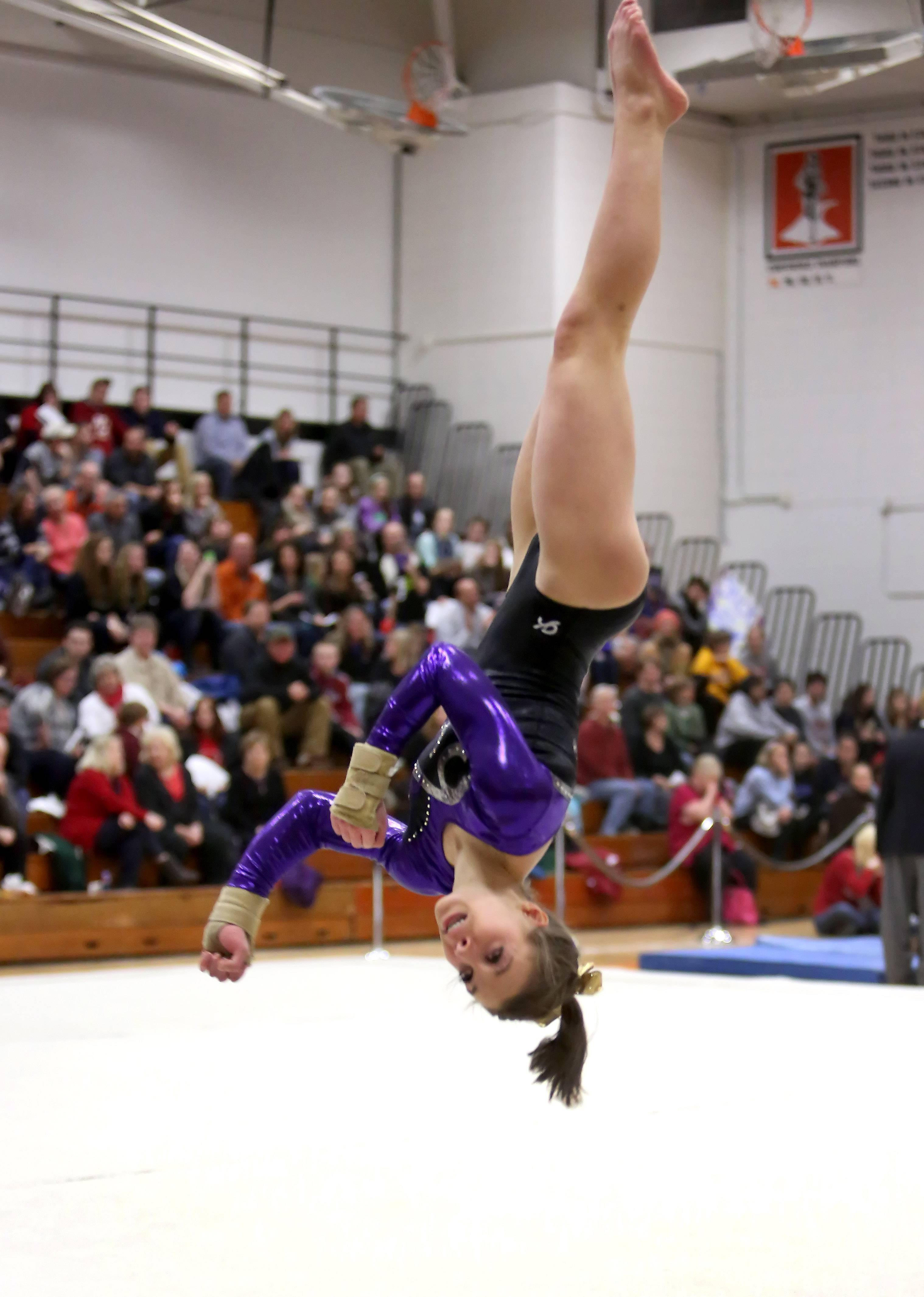 Audrey Channon of Wheaton Warrenville South performs her floor routine during gymnastics sectional at Wheaton Warrenville South on Tuesday in Wheaton.
