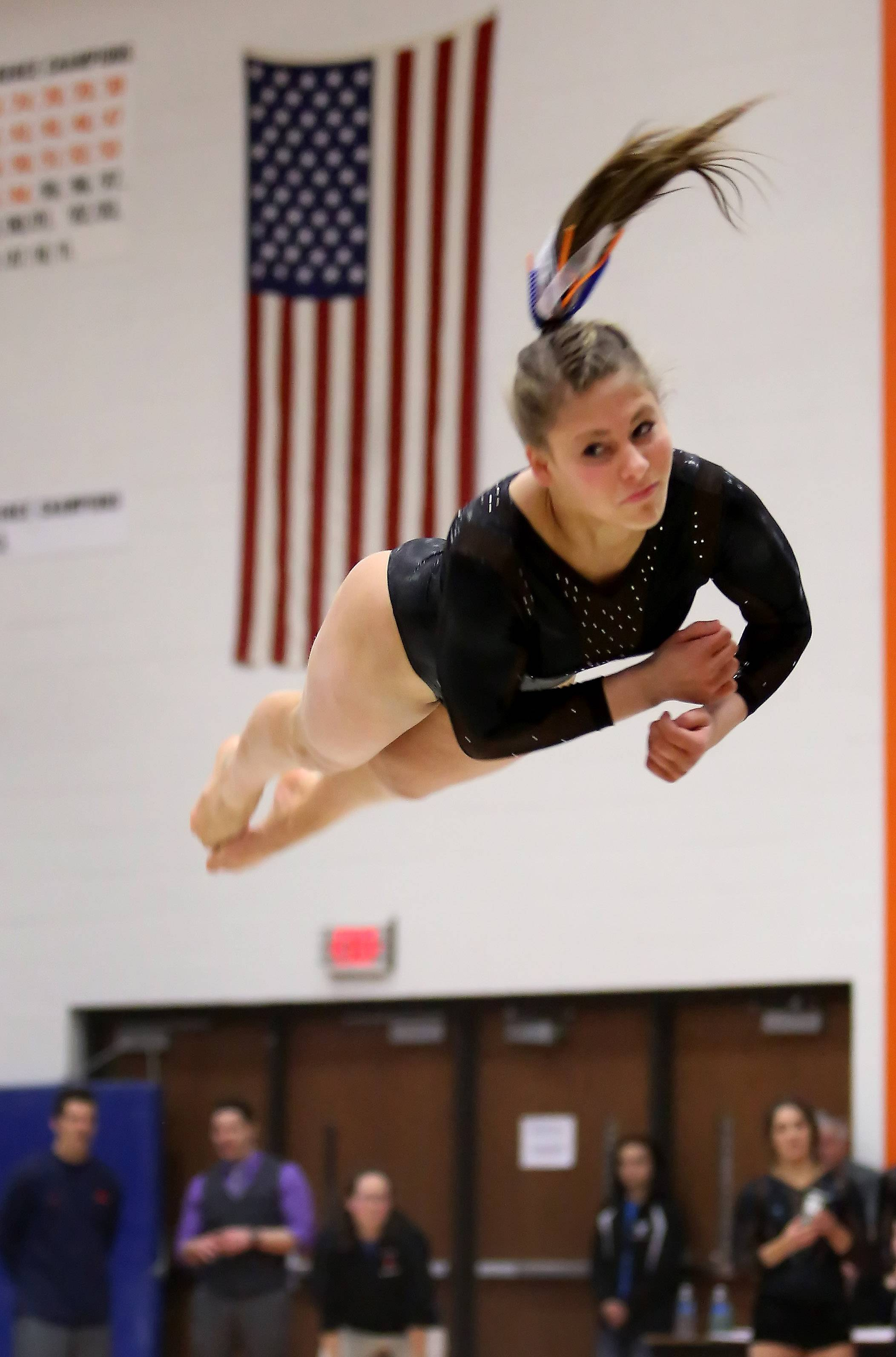 Rachel Dugan of St. Charles North performs her floor routine during gymnastics sectional at Wheaton Warrenville South on Tuesday in Wheaton.
