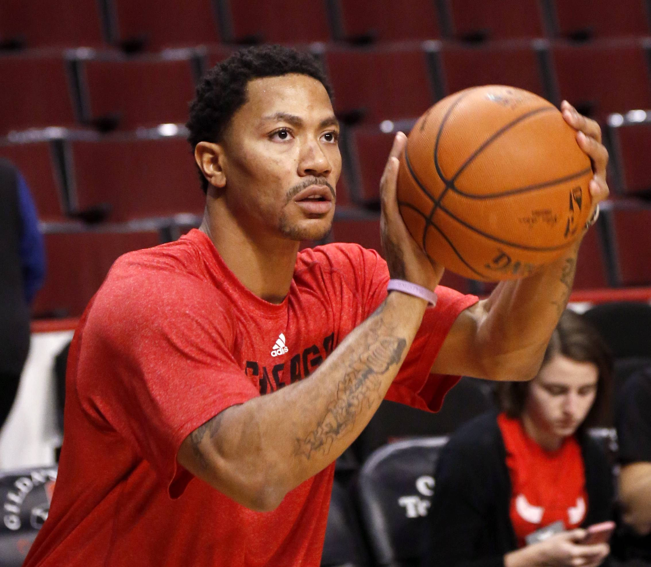 Chicago Bulls guard Derrick Rose works out before an NBA basketball game between the Bulls and the Atlanta Hawks on Tuesday, Feb. 11, 2014, in Chicago.