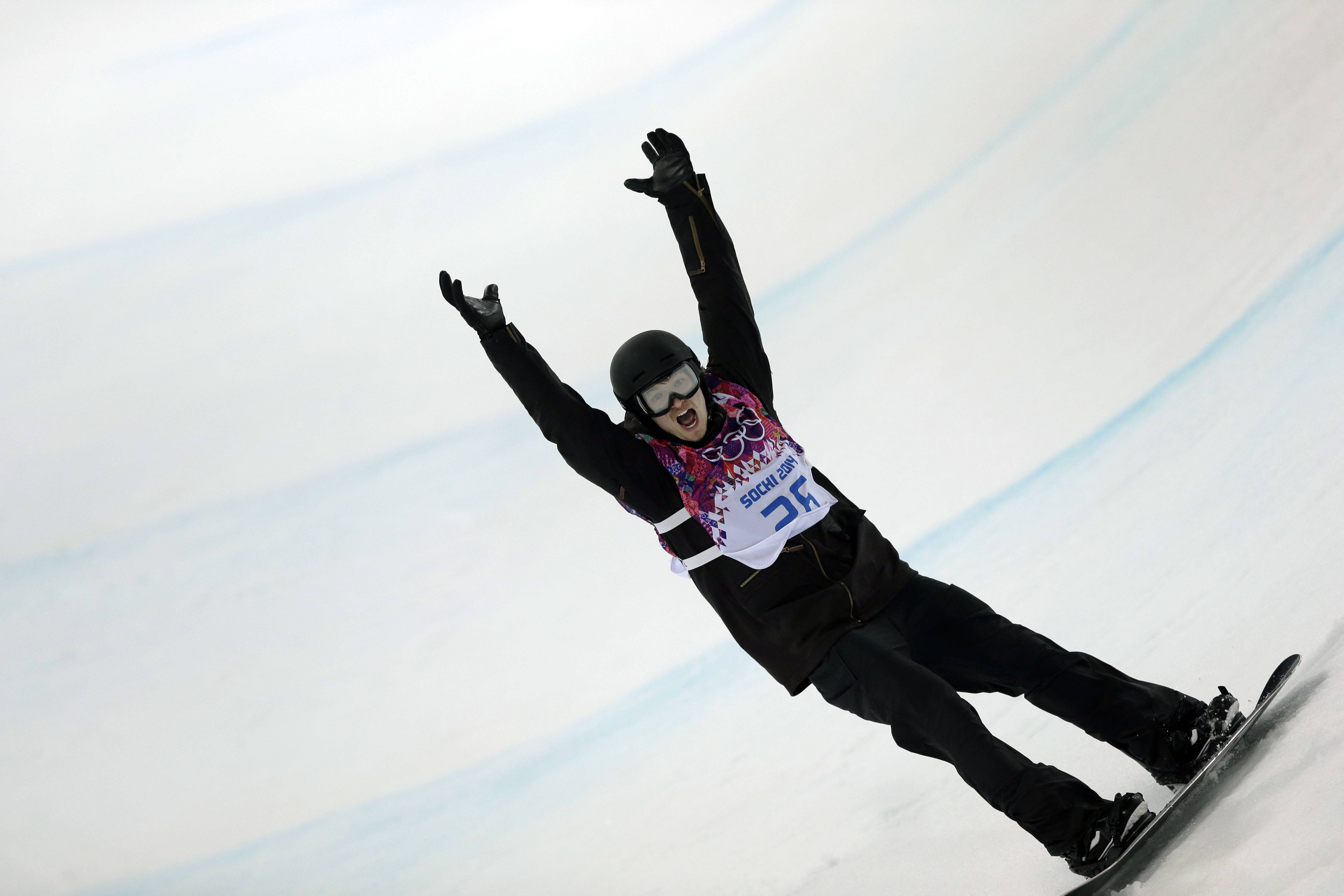 Switzerland's Iouri Podladtchikov celebrates after his second half pipe run during the men's snowboard halfpipe final at the Rosa Khutor Extreme Park, at the 2014 Winter Olympics, Tuesday, Feb. 11, 2014, in Krasnaya Polyana, Russia. Podladtchikov won the gold medal.