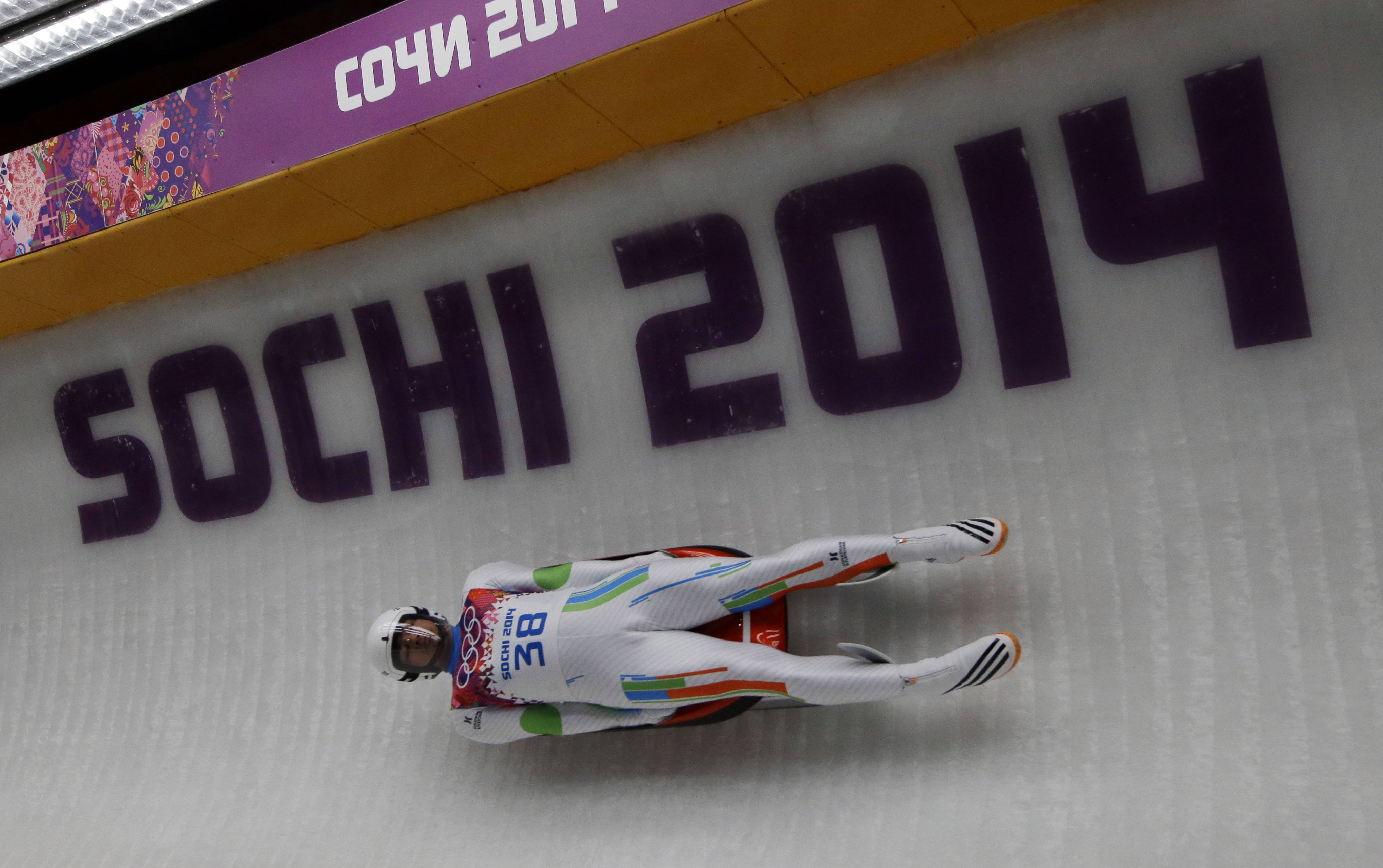Shiva Keshavan, who if from India but is competing under the Olympics flag, takes turn five in the third run during the men's singles luge final.