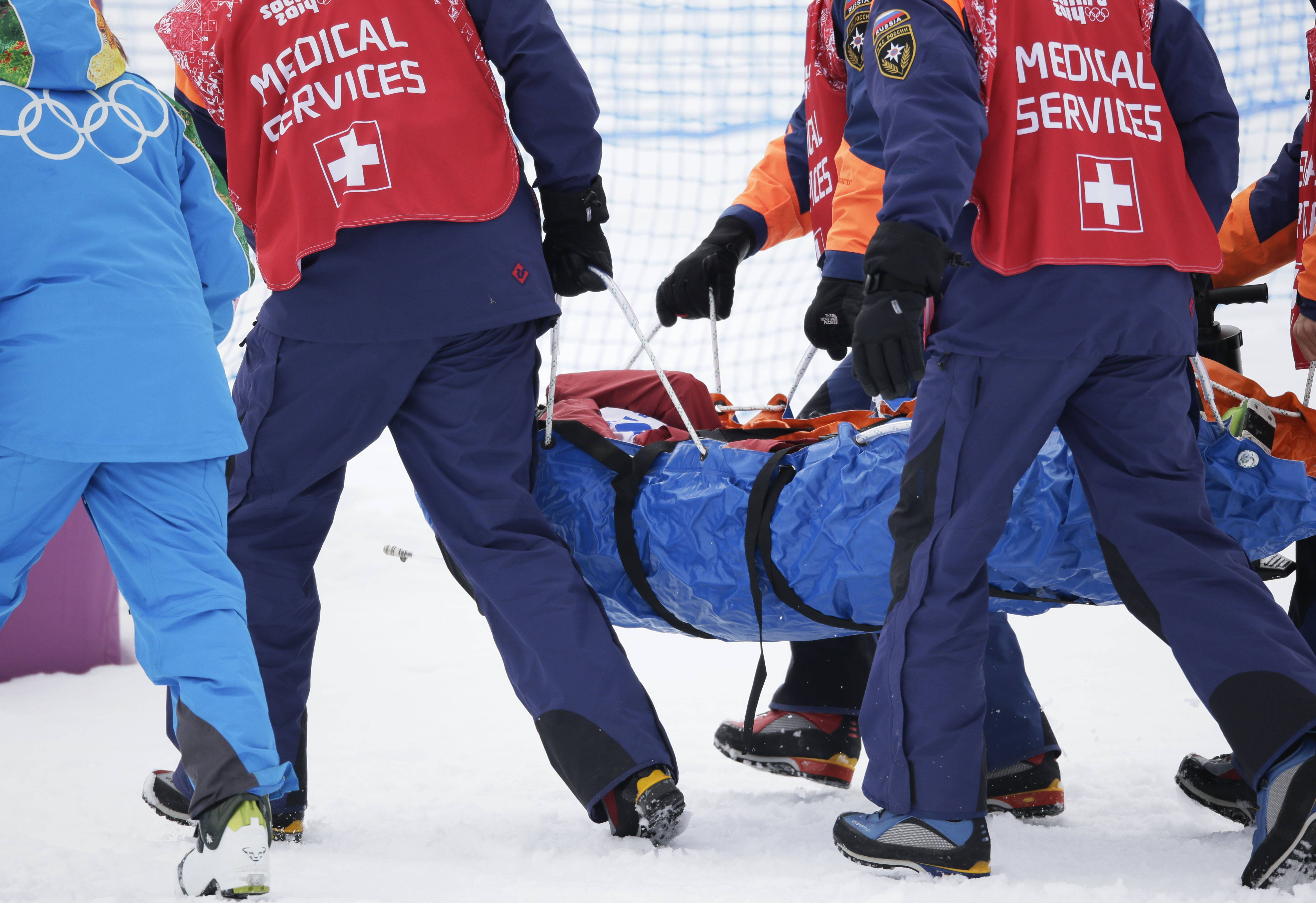 Canada's Yuki Tsubota is carried off in a stretcher after crashing during the women's freestyle skiing slopestyle final.