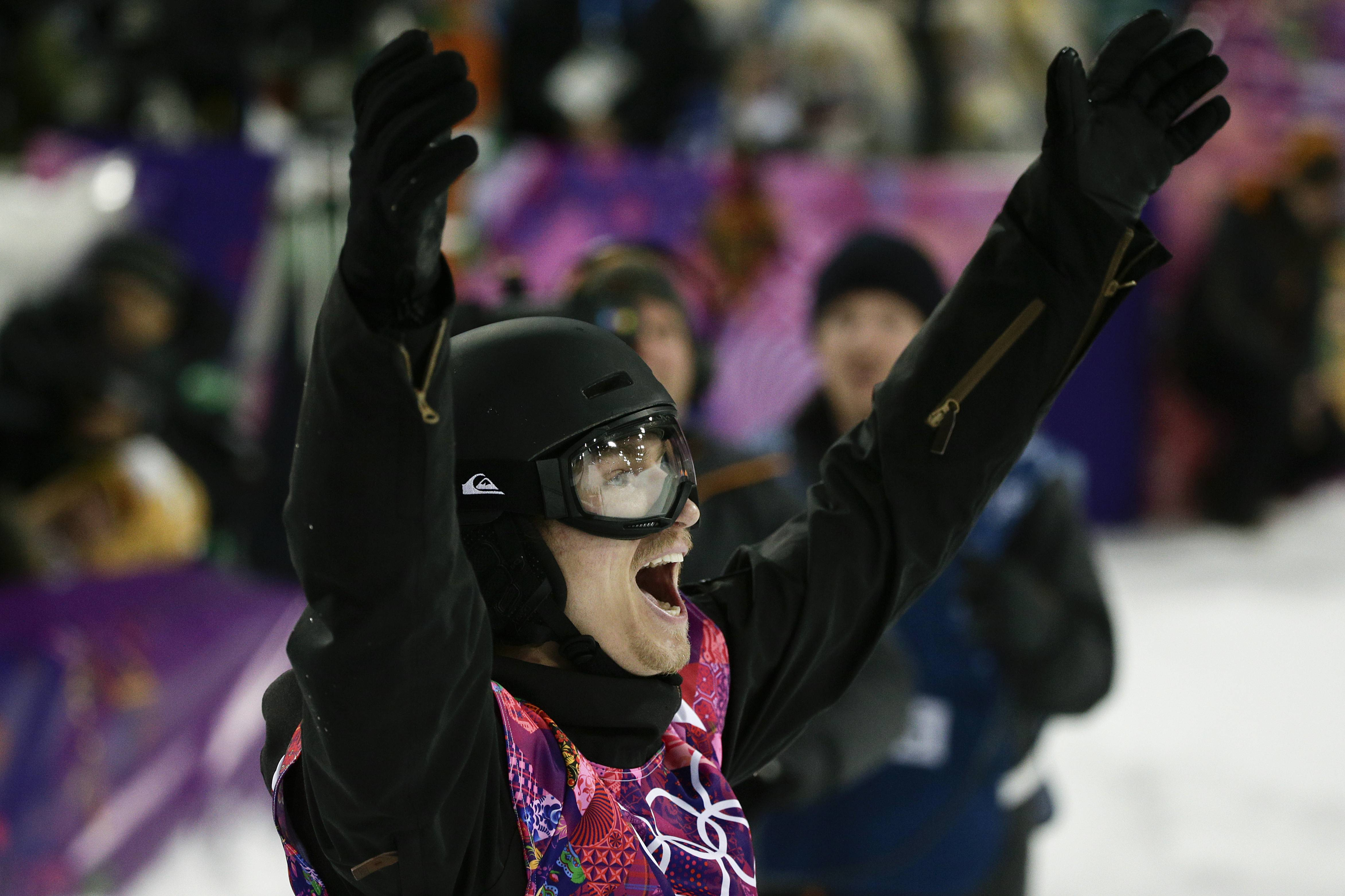 Switzerland's Iouri Podladtchikov celebrates after placing first in the men's snowboard halfpipe final.