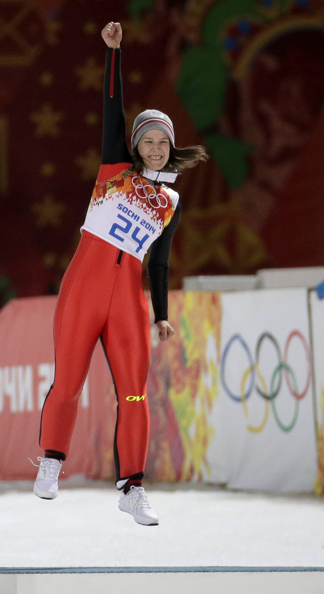 France's Coline Mattel celebrates during a flower ceremony after winning bronze in the women's normal hill ski jumping final,