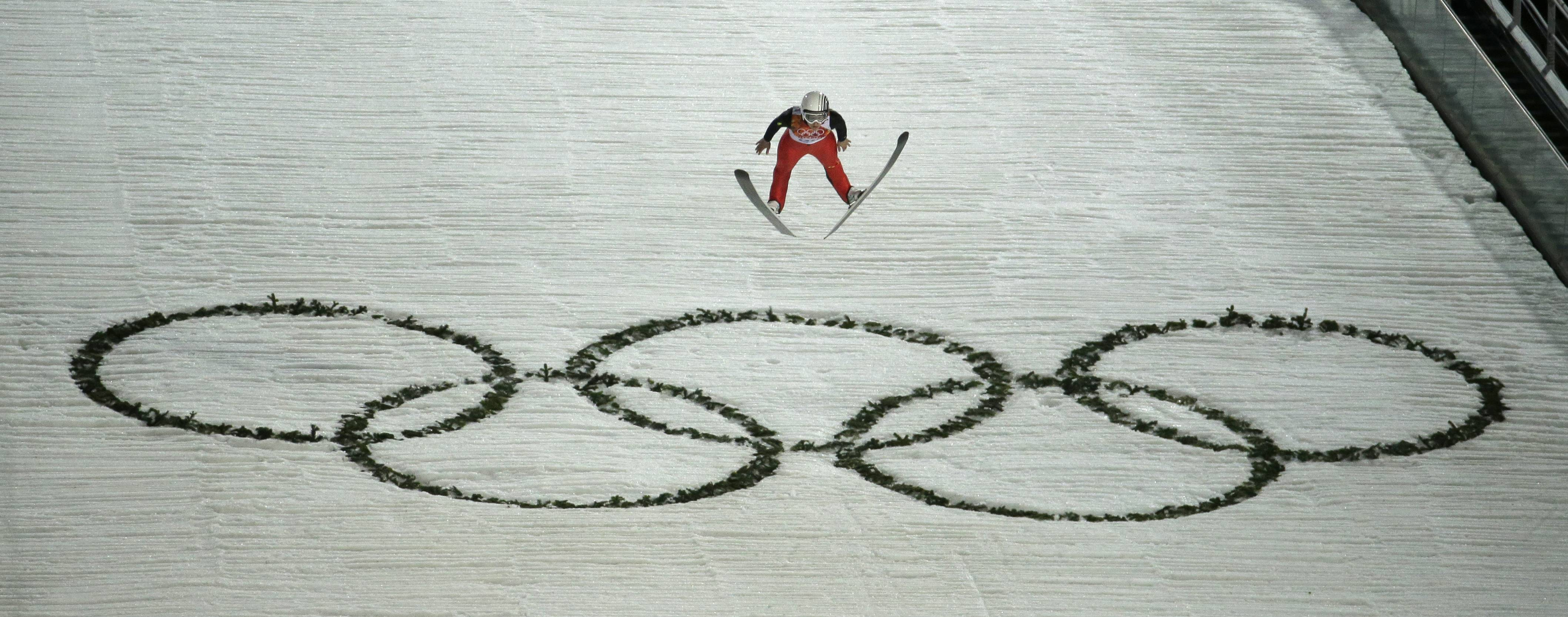 Bronze medalist, France's Coline Mattel takes her second jump in the women's normal hill ski jumping final.