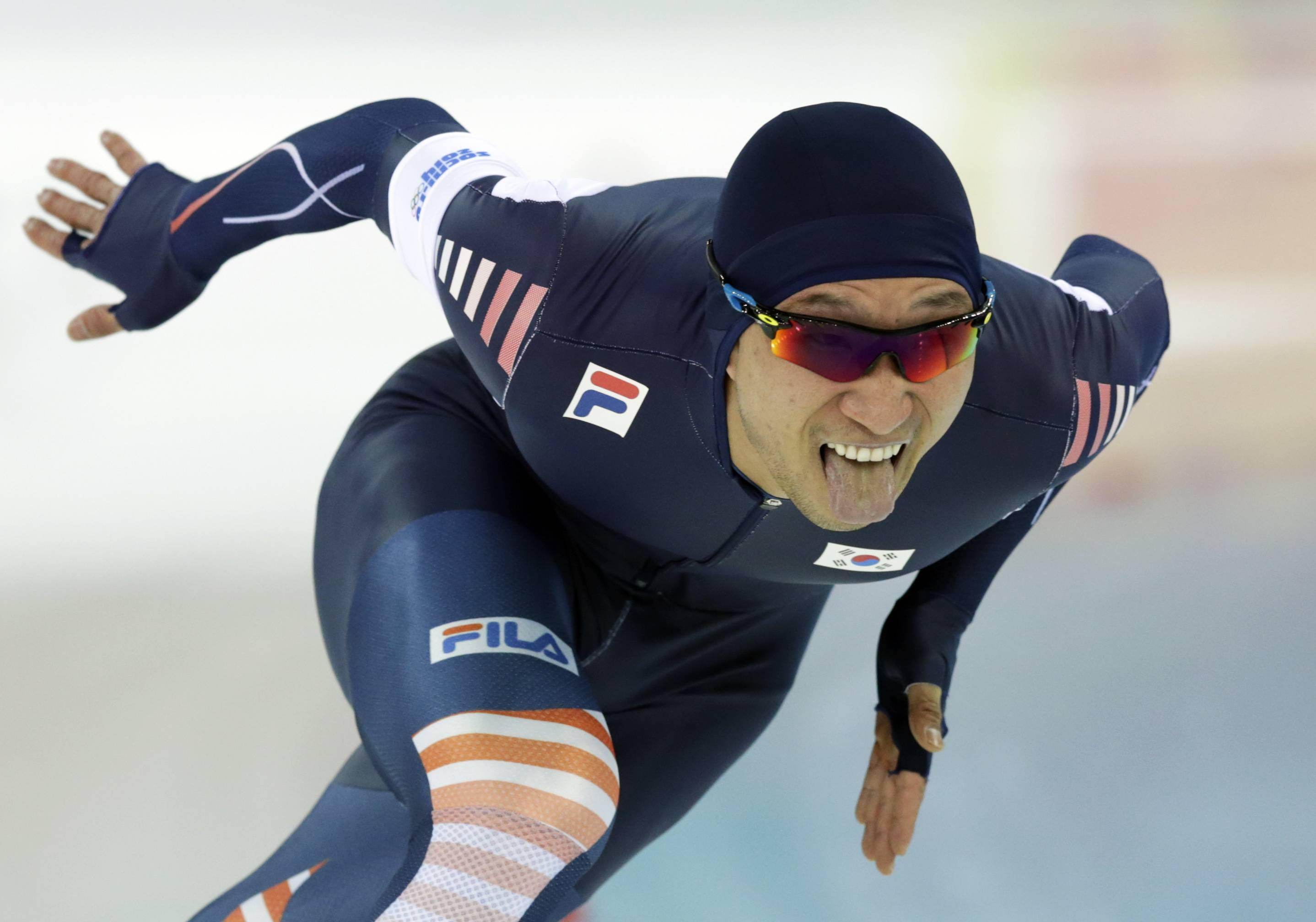 South Korea's Lee Kyou-hyuk competes during the second heat of the men's 500-meter speedskating race.