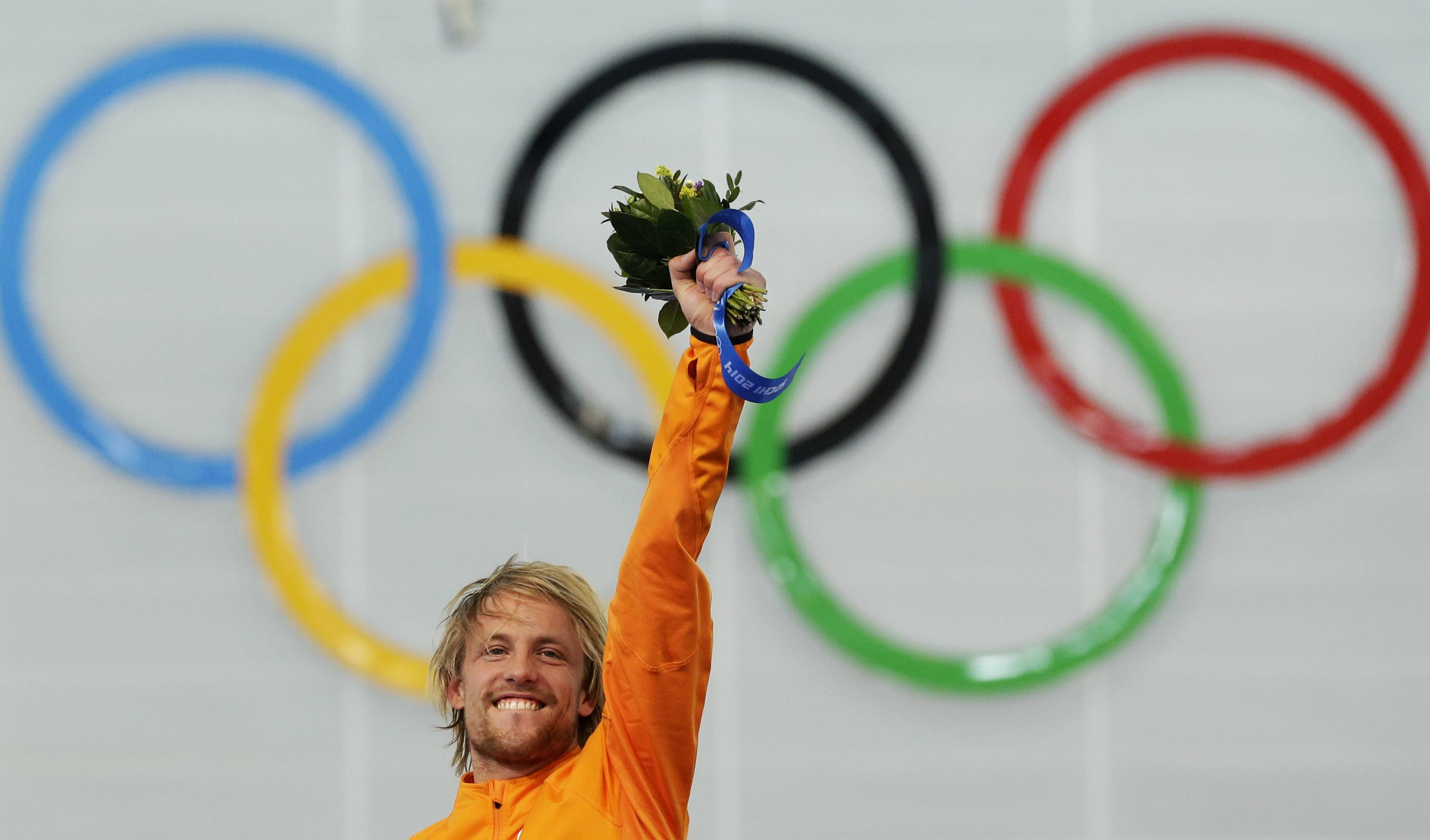 Gold medallist Michel Mulder of the Netherlands celebrates during the flower ceremony for the men's 500-meter speedskating race.