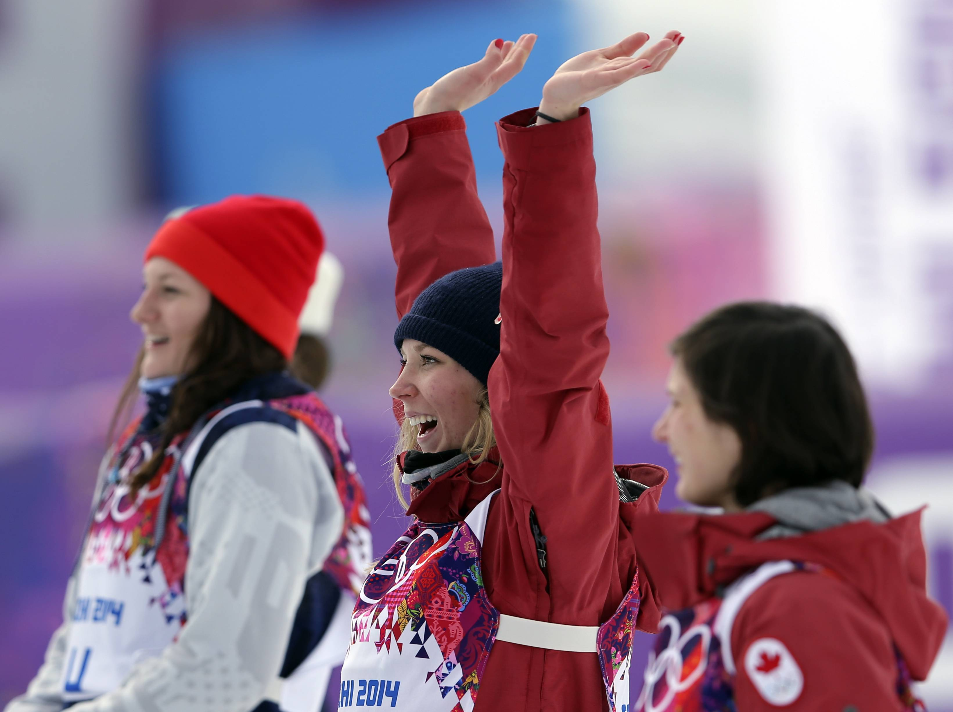 Canada's Dara Howell, center, celebrates after taking the gold medal in the women's freestyle skiing slopestyle final.  With her are silver medalist Devin Logan of the United States, left, and bronze medalist  Kim Lamarre of Canada.
