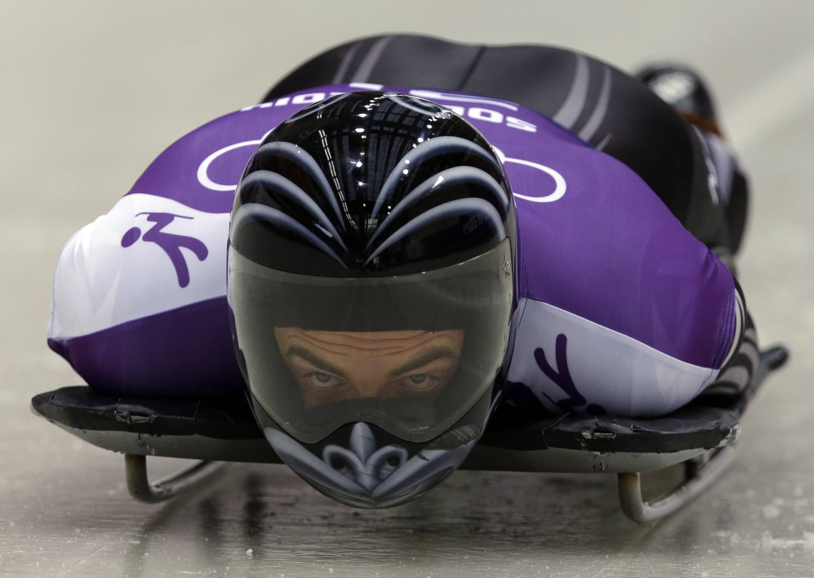 Ben Sandford of New Zealand starts a run during the men's skeleton training.