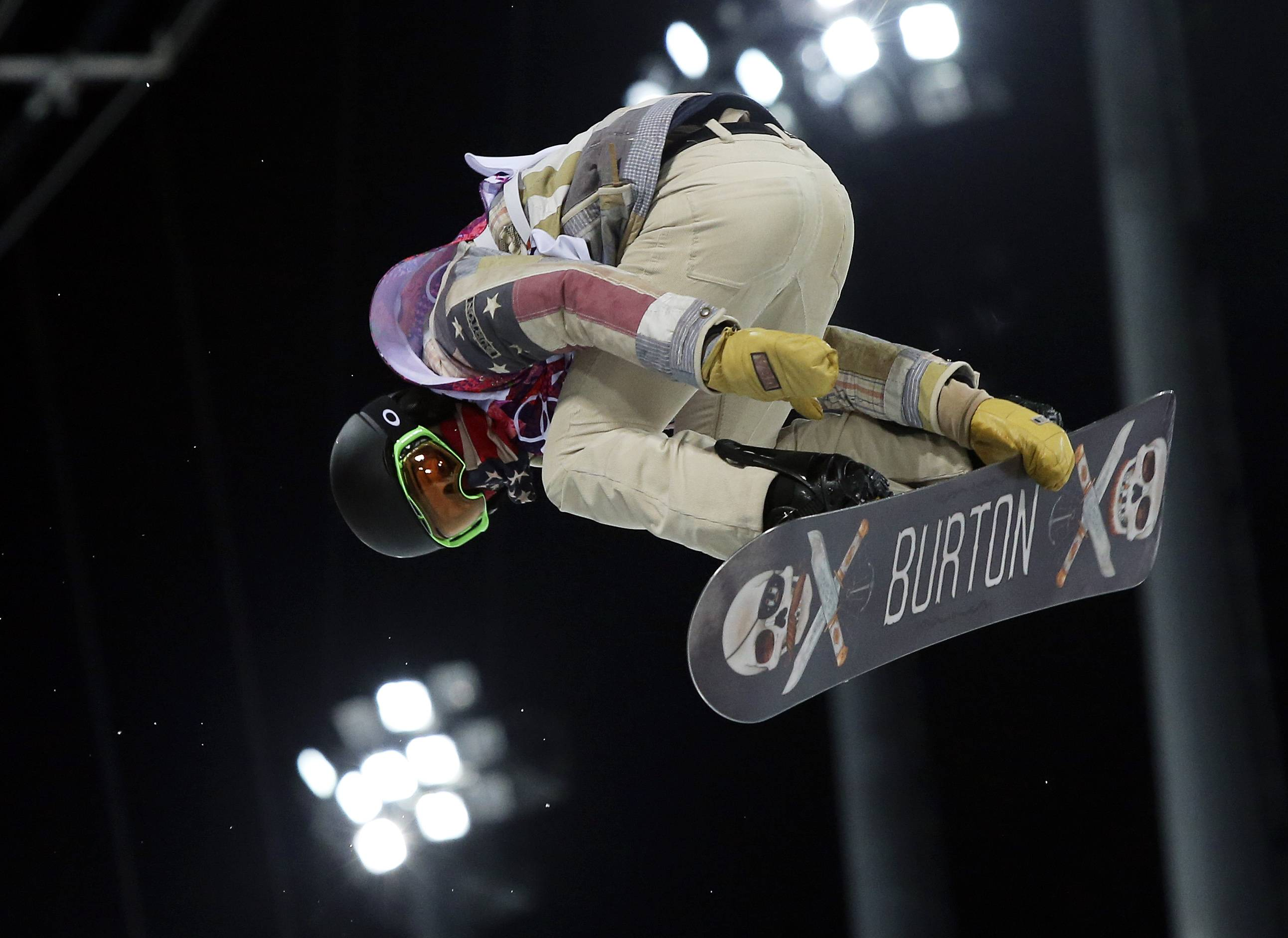 Shaun White gets air Monday during a snowboard half pipe training session at the Rosa Khutor Extreme Park at the 2014 Winter Olympics in Krasnaya Polyana, Russia.