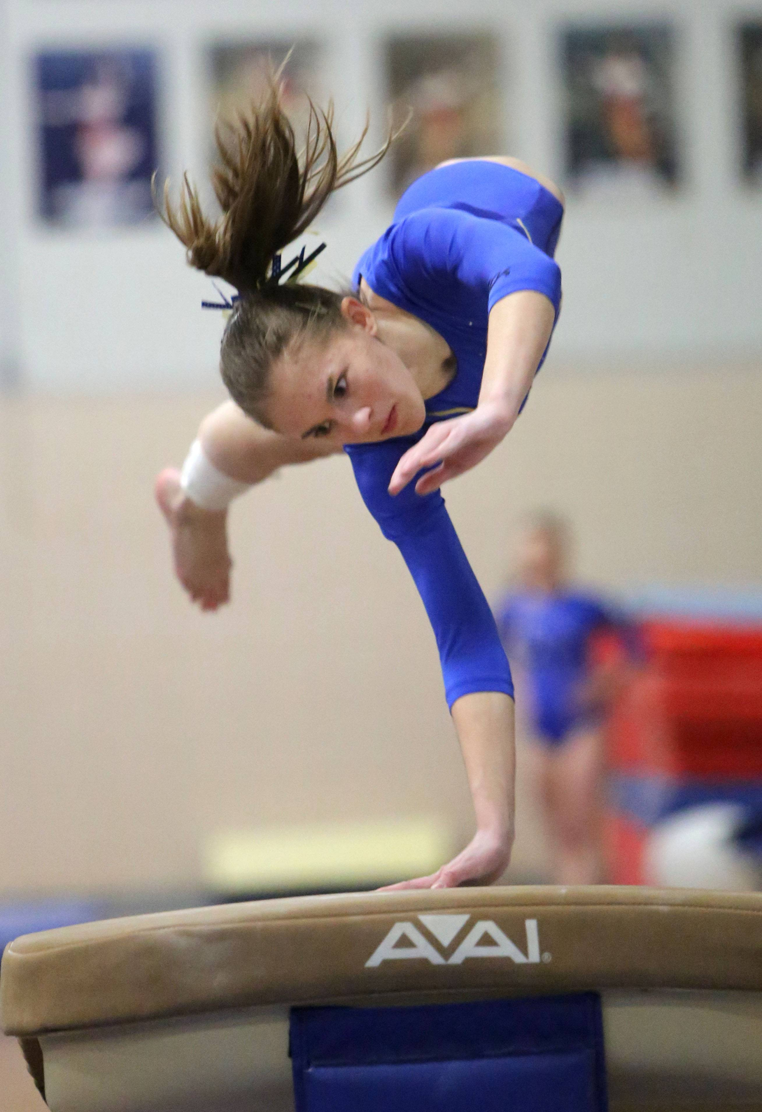 Warren's Katie Graeb competes on the vault during girls regional gymnastics Tuesday at Deerfield High School.